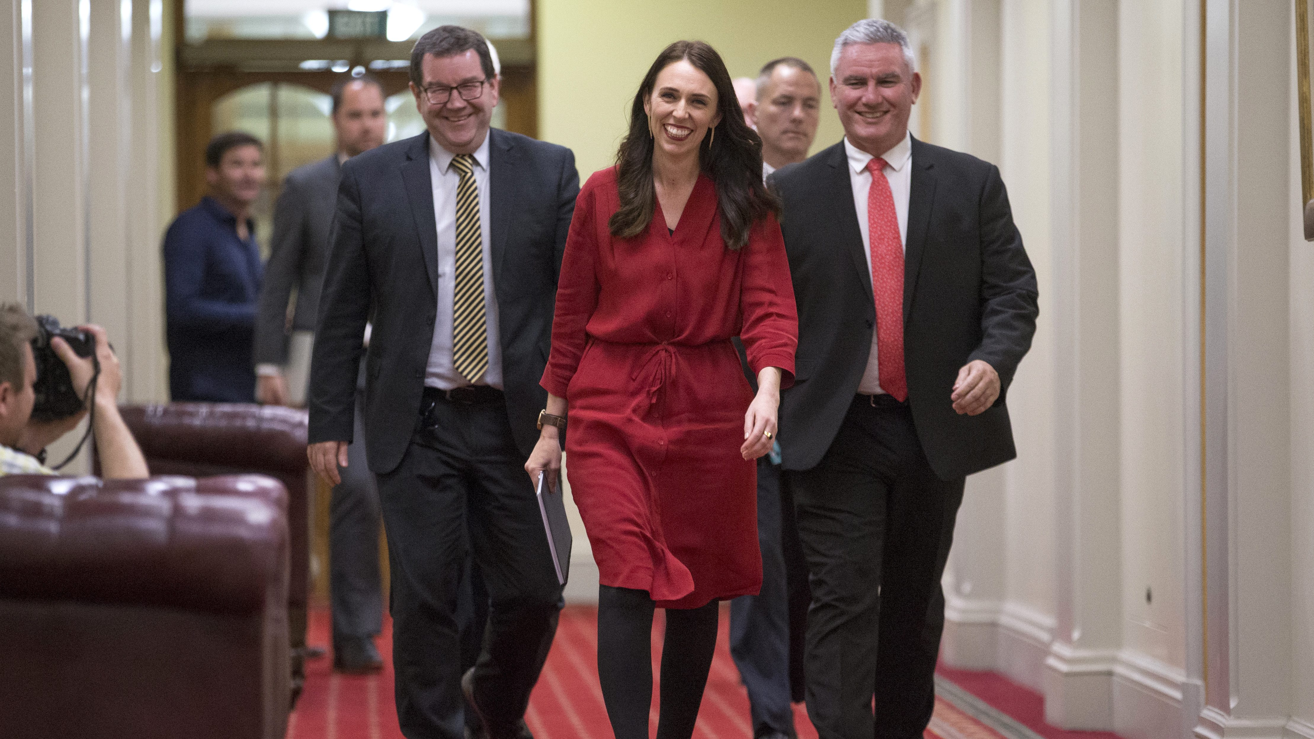 New Zealand Labour Party leader Jacinda Ardern, center, walks with colleagues to a press conference at Parliament in Wellington, New Zealand, Thursday Oct. 19, 2017. Ardern will be New Zealand's next prime minister after a small political party chose to make a deal with liberals following the nation's election nearly a month ago. (Mark Mitchell/New Zealand Herald via AP)