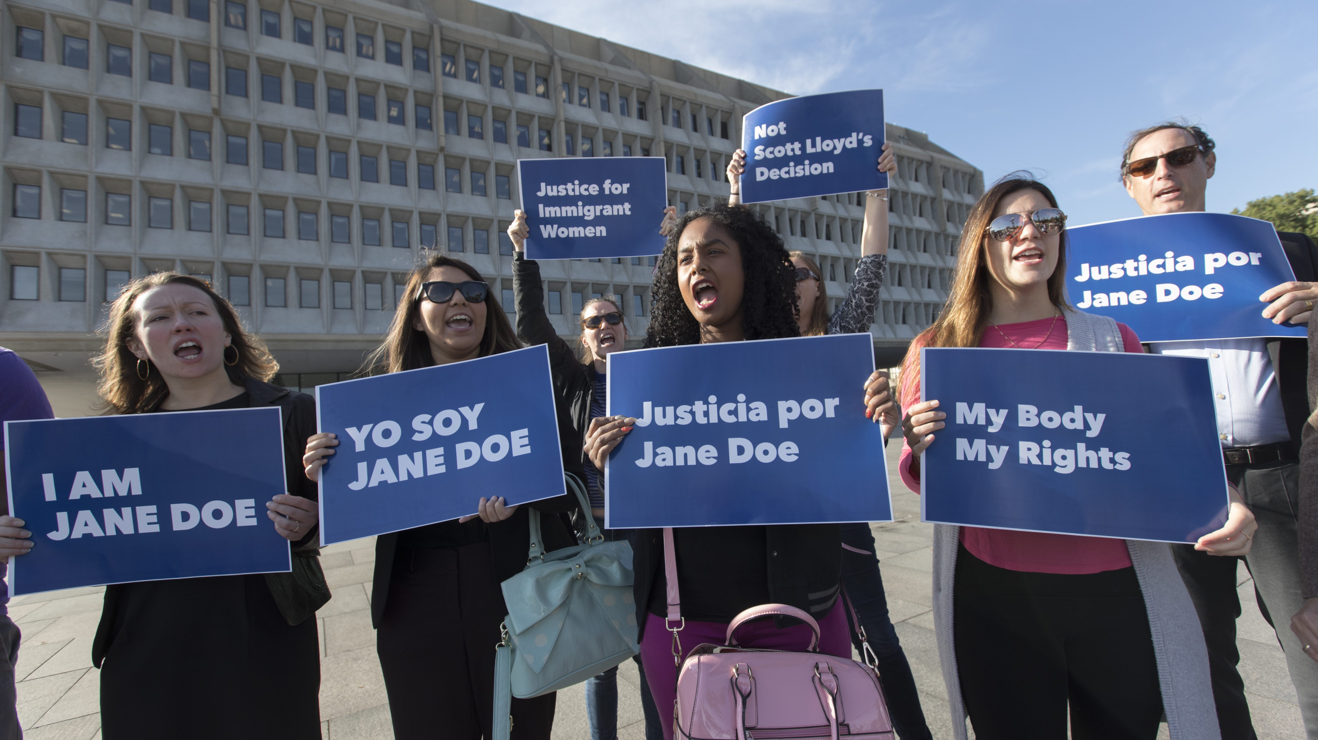 Activists with Planned Parenthood demonstrate in support of a pregnant 17-year-old being held in a Texas facility for unaccompanied immigrant children to obtain an abortion, outside of the Department of Health and Human Services in Washington, Friday, Oct. 20, 2017. (AP Photo/J. Scott Applewhite)