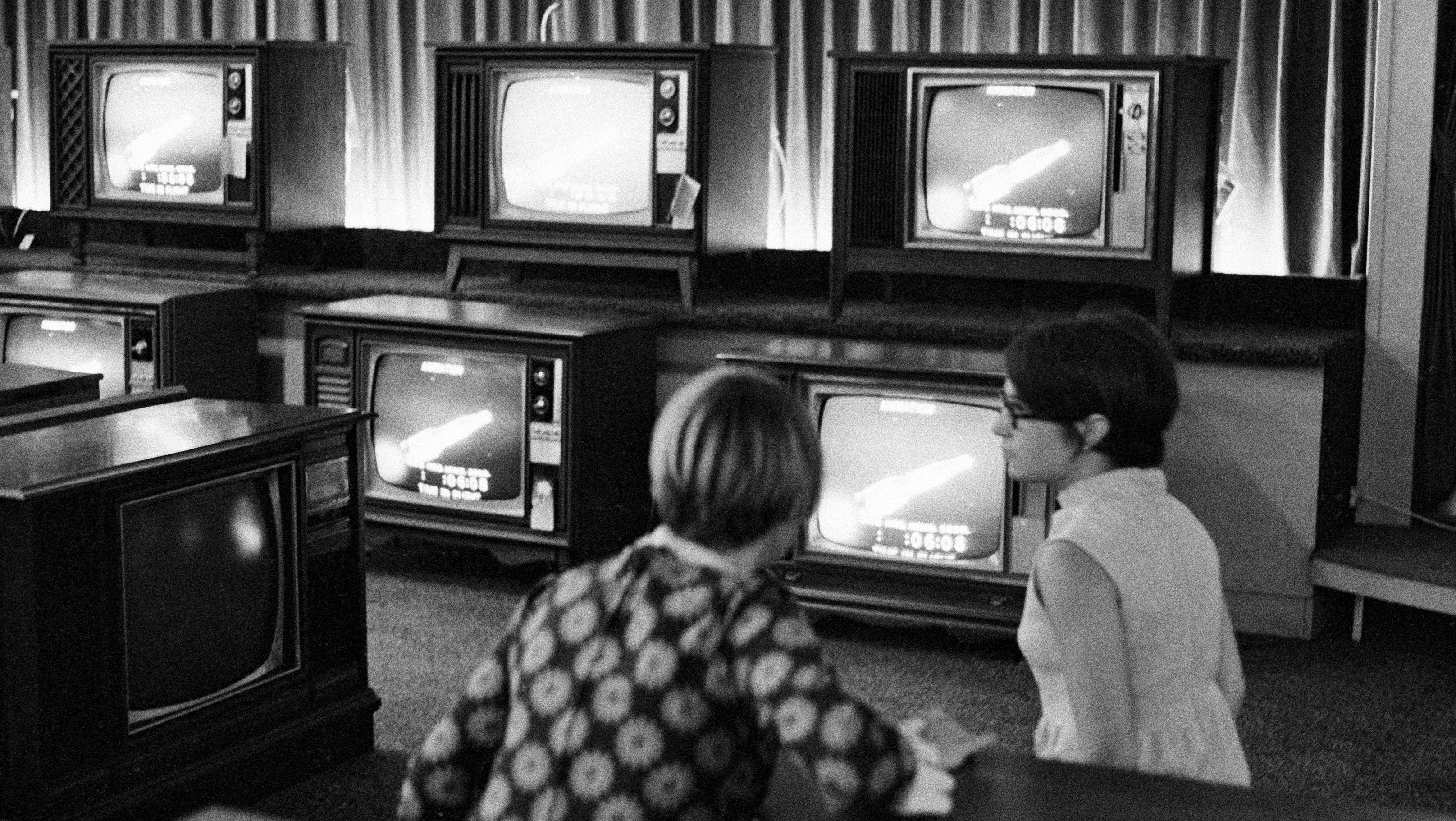 People watch the Apollo 11 Saturn V rocket launch on multiple TV's at a Sears department store in White Plains, N.Y., July 16, 1969. (AP Photo/Ron Frehm)
