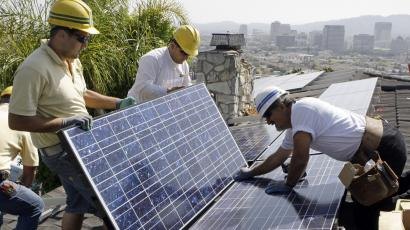 Solar panel installers at work