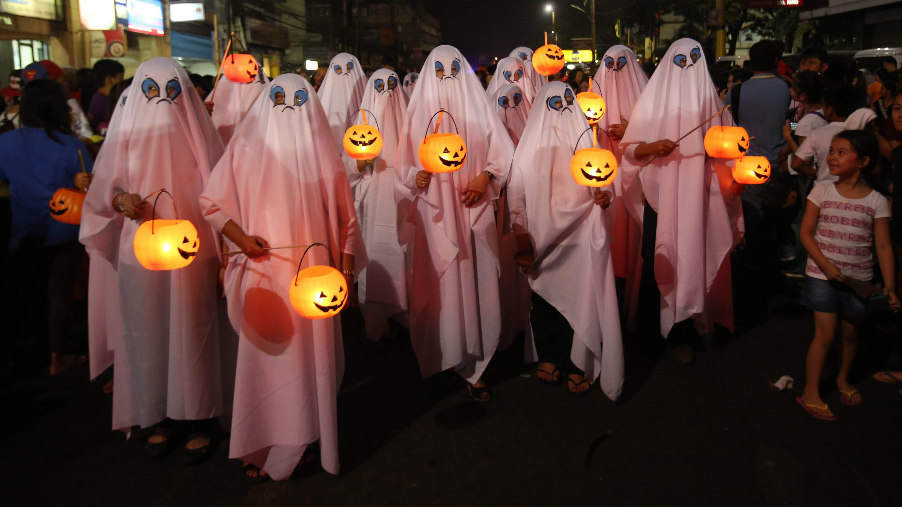 Filipinos wear ghost costumes as they join a Halloween Parade in Marikina city, east of Manila, Philippines on Wednesday, Oct. 30, 2013. Hundreds of residents and government employees joined the parade as the country prepares to observe All Saints Day on Nov. 1.