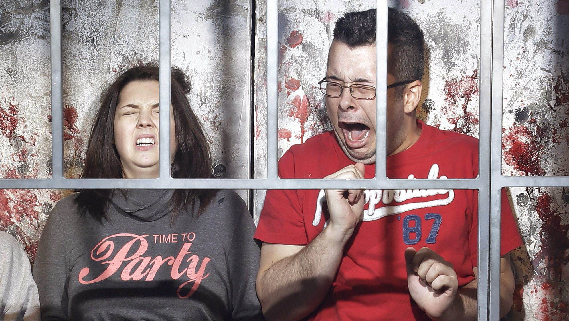 "In this Oct. 27, 2014, photo, people react to a mock execution in the Gates of Hell haunted house in Las Vegas. The haunted house is billed as an ""R-rated haunted attraction"" and according to JT Mollner, a managing partner of Freakling Bros that runs the attraction, about one in five groups are so terrified they exit the house early. (AP Photo/John Locher)"