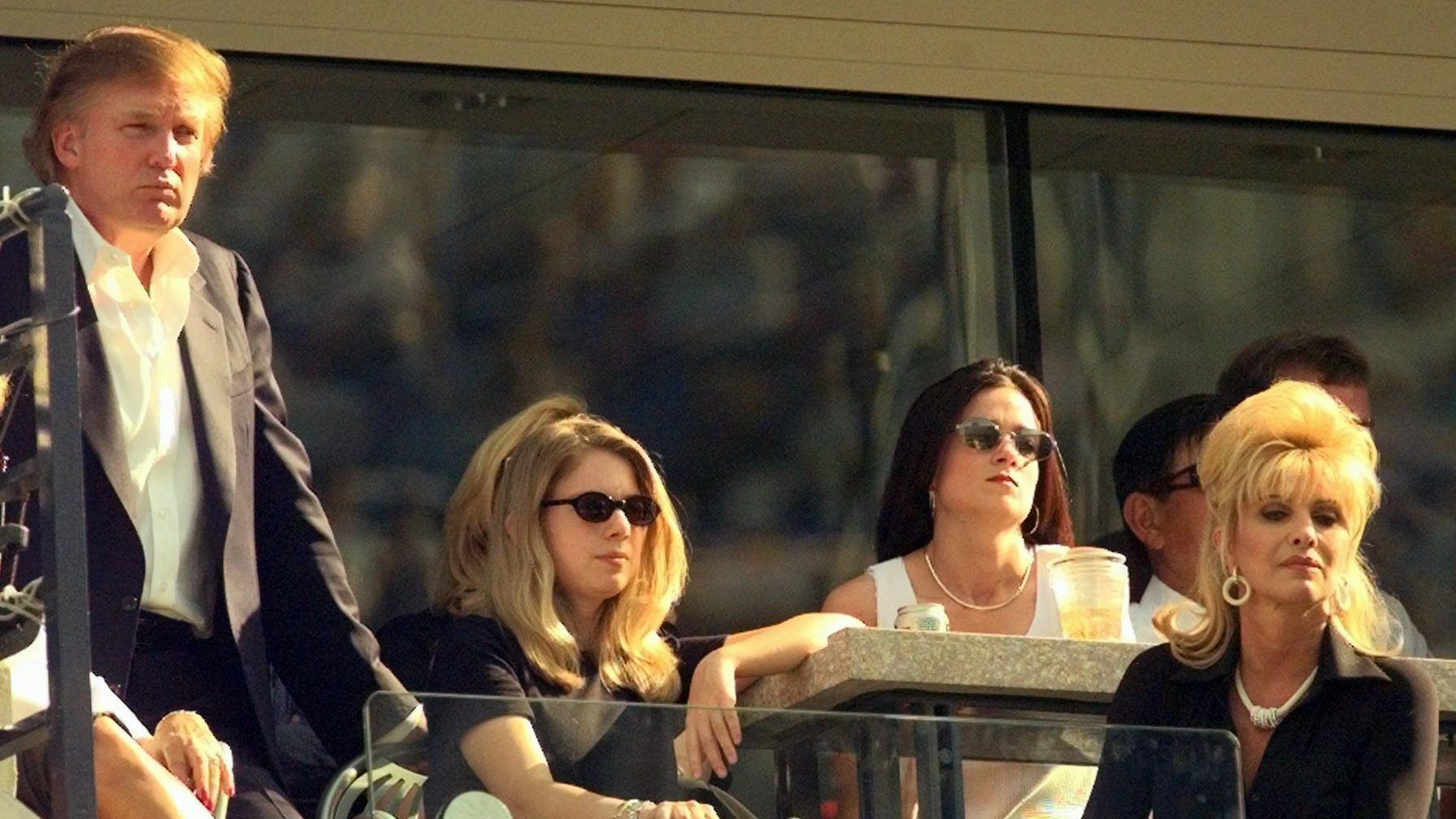 Donald Trump, left, his daughter Ivanka, center, and ex-wife Ivana watch the men's semifinal match from their box at the U.S. Open in New York Saturday, Sept. 6, 1997.   (AP Photo/Richard Drew)