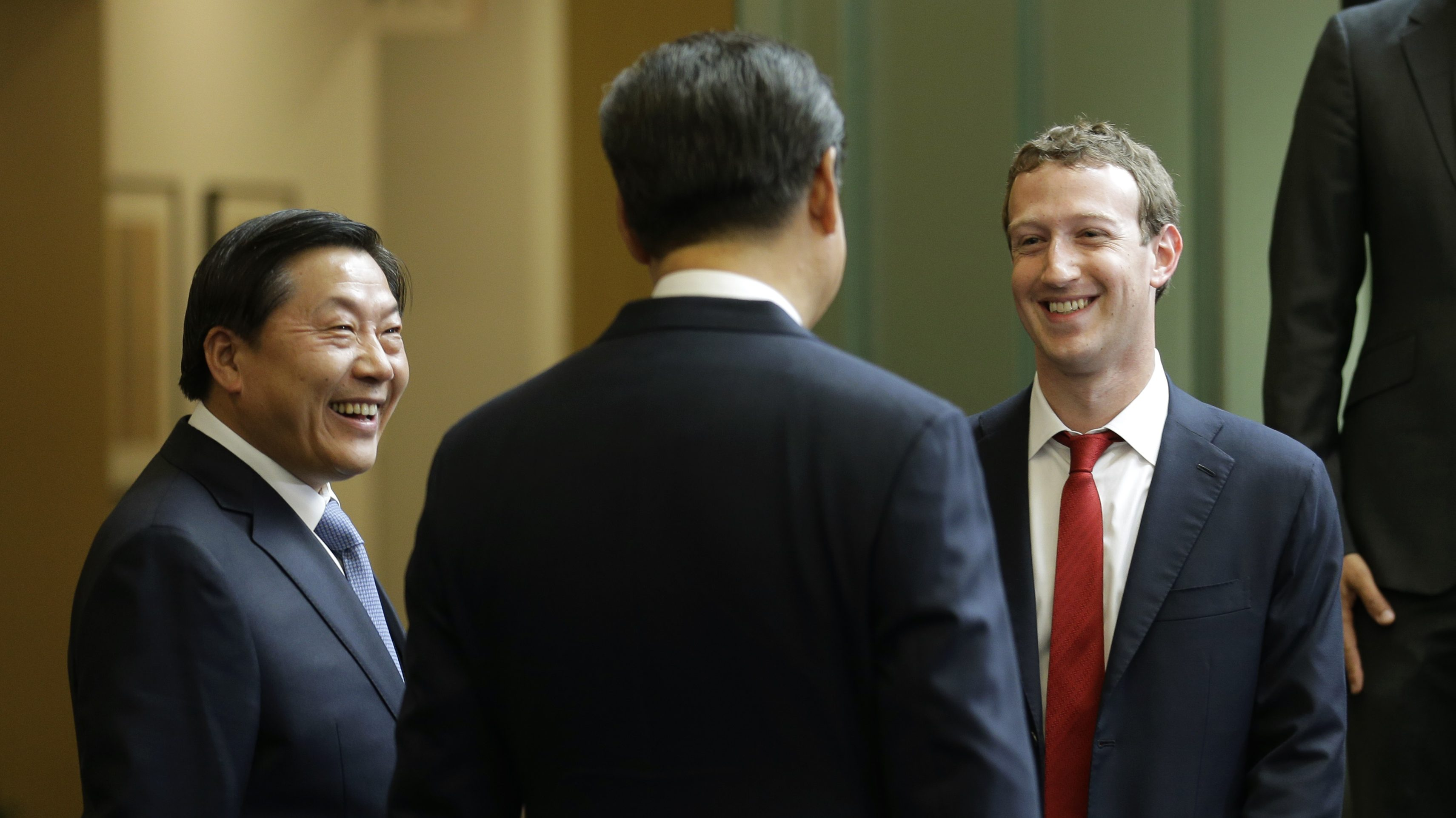 Chinese President Xi Jinping, center, talks with Facebook Chief Executive Mark Zuckerberg, right, as Lu Wei, left, China's Internet czar, looks on during a gathering of CEOs and other executives at Microsoft's main campus in Redmond, Wash., Wednesday, Sept. 23, 2015. (AP Photo/Ted S. Warren, Pool)
