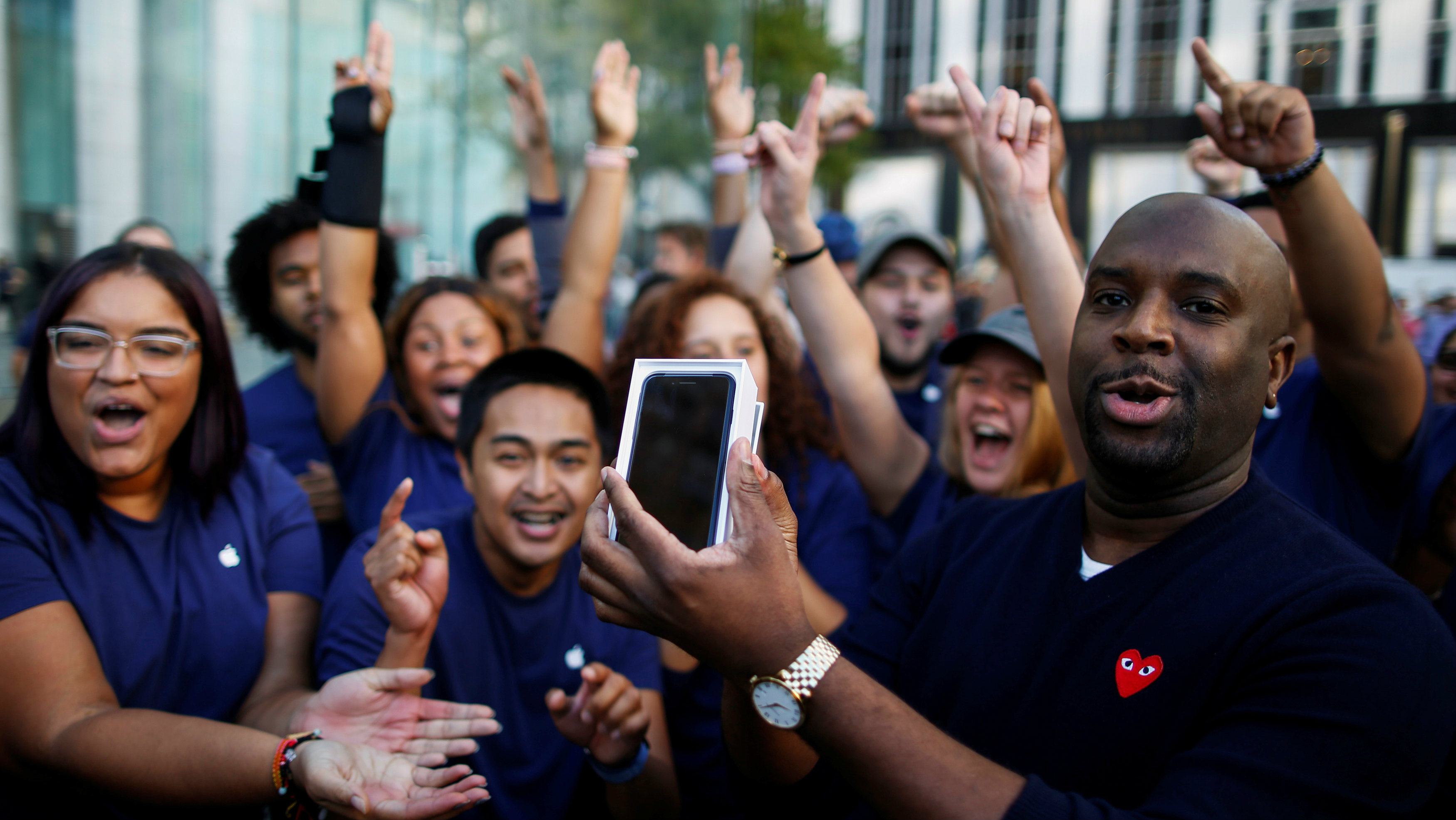DATE IMPORTED:September 16, 2016A customer celebrates with Apple workers after buying a new iPhone