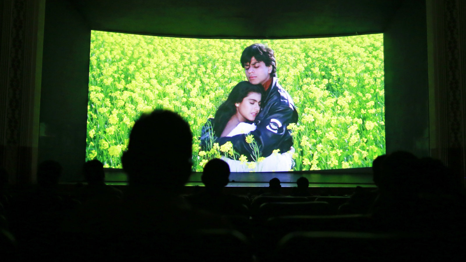 "Bollywood actors Shah Rukh Khan (R) and Kajol (L) are seen on the screen during the screening of ""Dilwale Dulhania Le Jayenge"" (The Big Hearted Will Take the Bride) inside Maratha Mandir theatre in Mumbai December 11, 2014. The movie, released in October 1995, has set a record of completing 1000 weeks of continuous screening at a cinema, a feat unmatched by any other Bollywood movies. According to Manoj Desai, owner of the theatre, the movie, which is still being screened, enjoys at least 50 to 60 percent occupancy on weekdays and full house on weekends at his theatre. The movie is screened only in the morning and the ticket price ranges from 15 to 20 Indian rupees ($0.24-$0.32). Picture taken December 11, 2014."