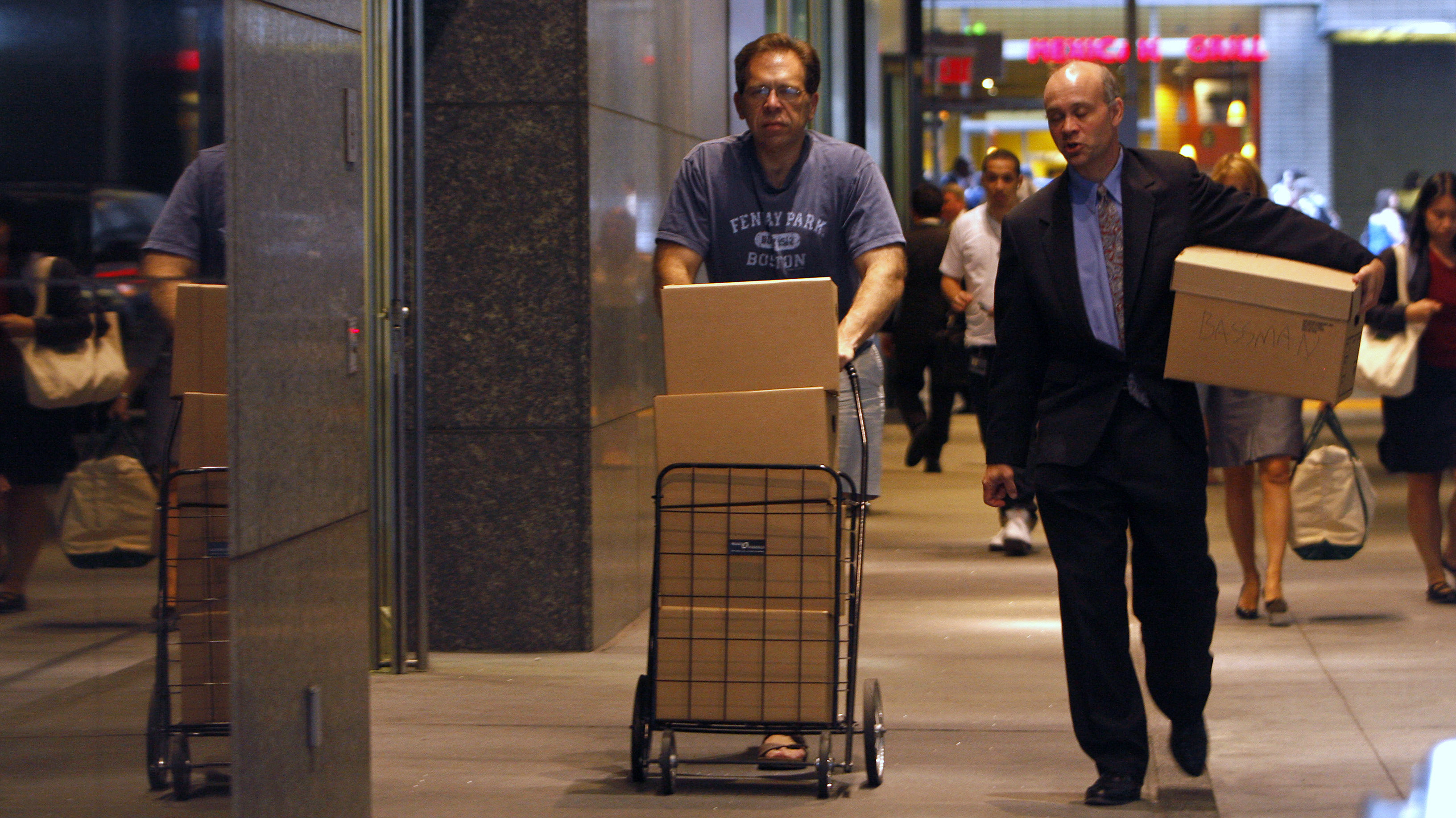 Two men walk out of the Lehman Brothers building with boxes in New York September 15, 2008. Stunned and angry, Lehman Brothers' employees packed their bags at company headquarters in New York, with some bitterness over the 158-year-old company's failure aimed at Chief Executive Richard Fuld.