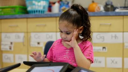 A Pre-K student uses an electronic tablet at the South Education Center, in San Antonio. (AP Photo/Eric Gay)
