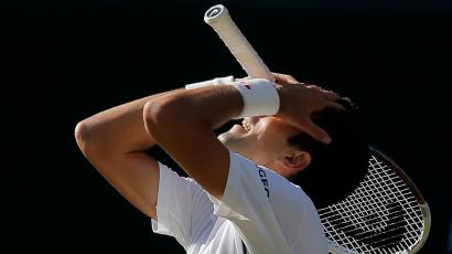Novak Djokovic of Serbia puts his head in his hands after losing a point during the men's singles final against Roger Federer of Switzerland at the All England Lawn Tennis Championships in Wimbledon, London, Sunday, July 6, 2014. (AP Photo/Pavel Golovkin)