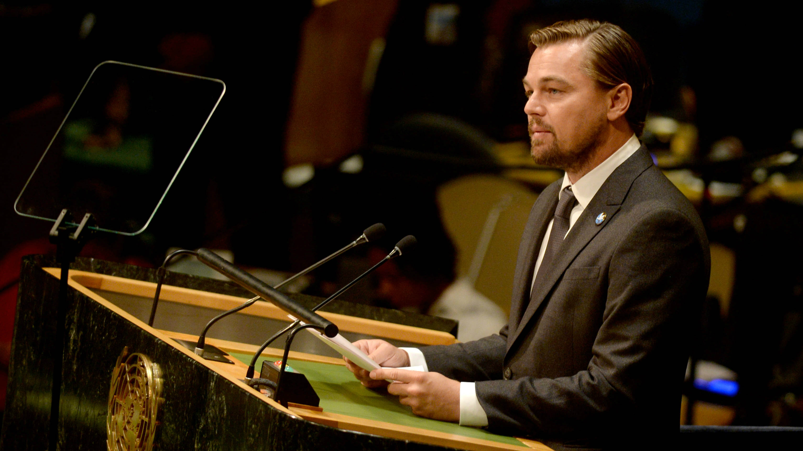 Leonardo DiCaprio speaking at a lectern