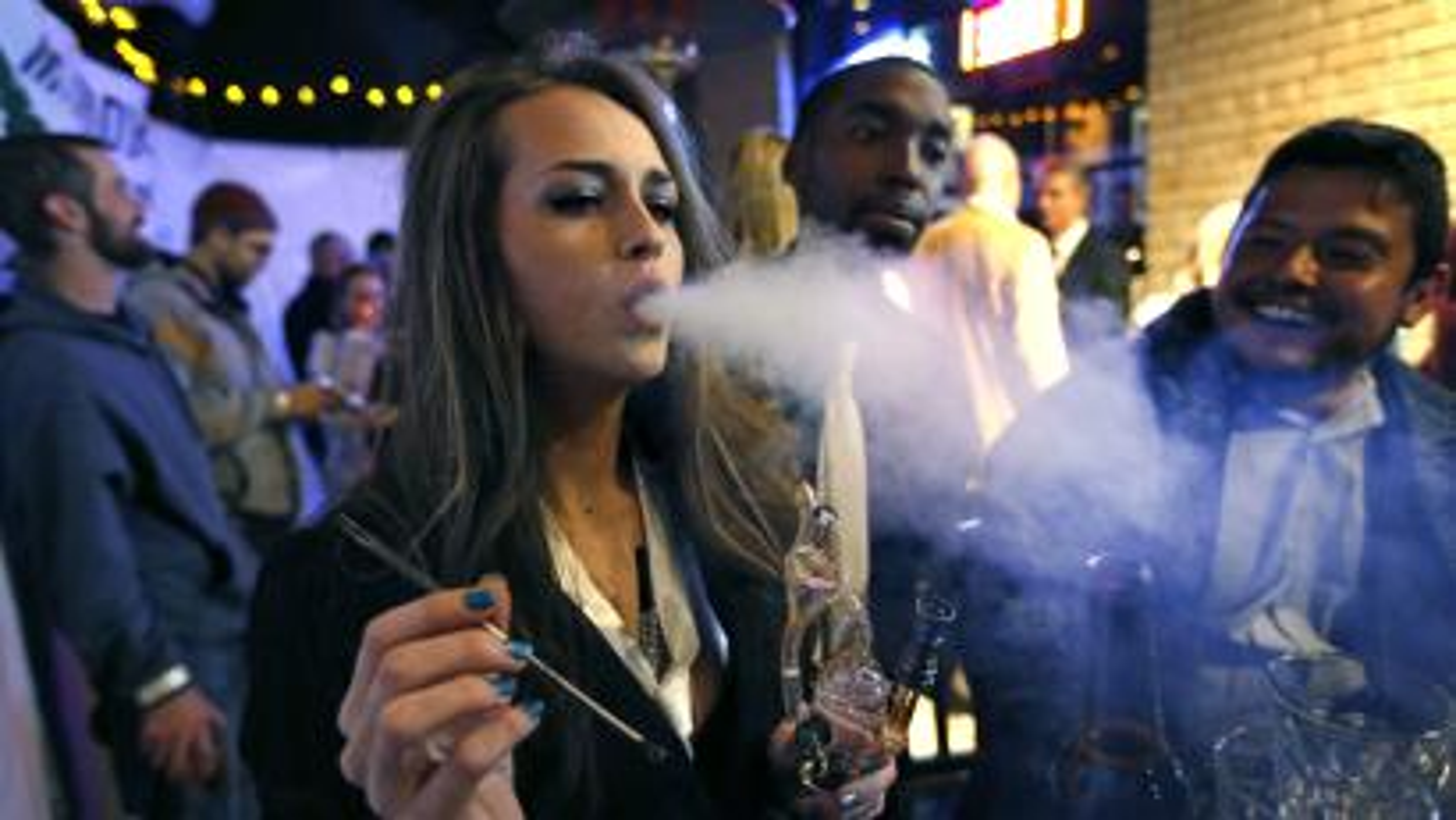 A woman smoking pot.