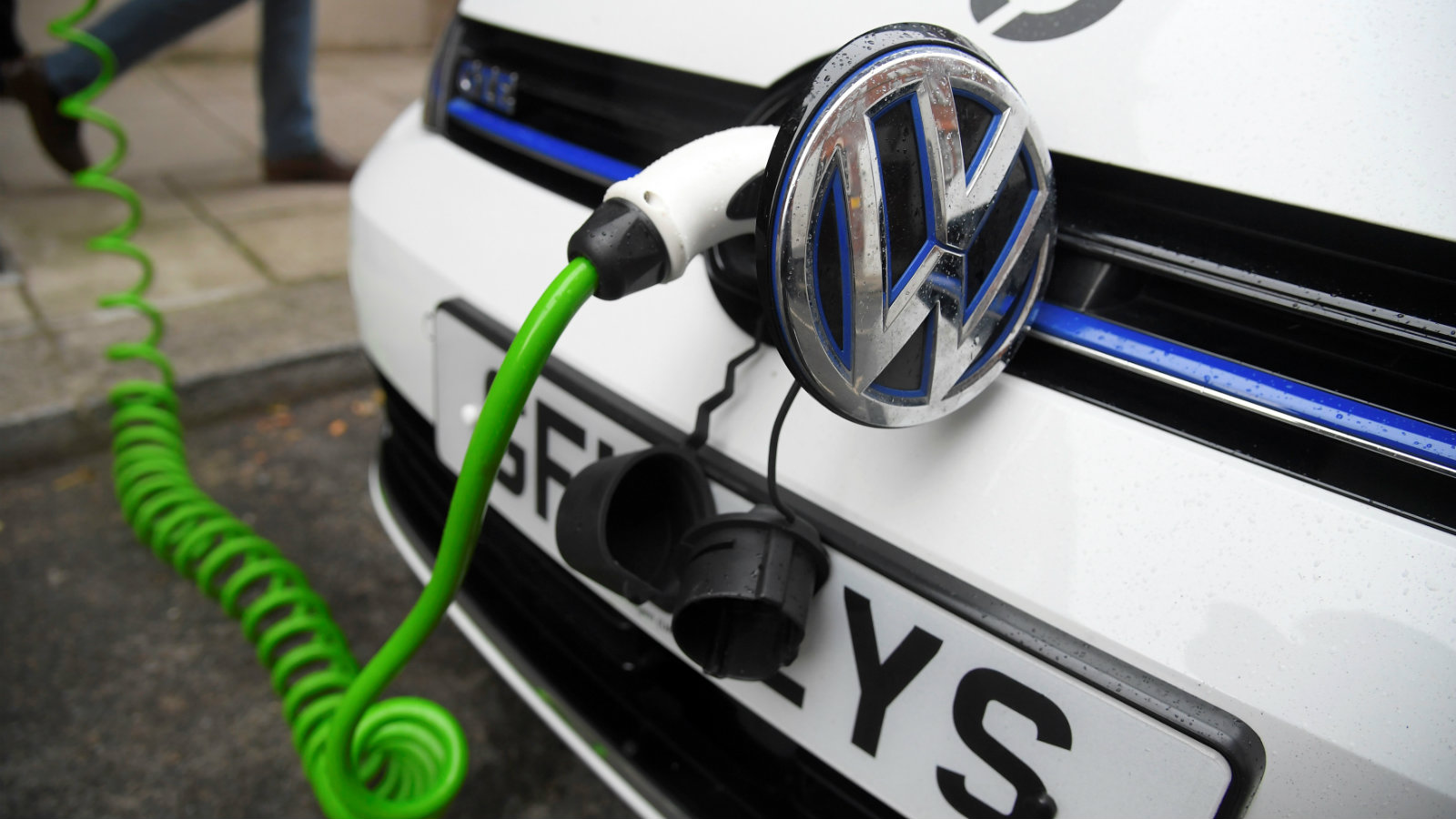 An electric Volkswagen car is plugged into a recharging point in central London, Britain November 10, 2016.