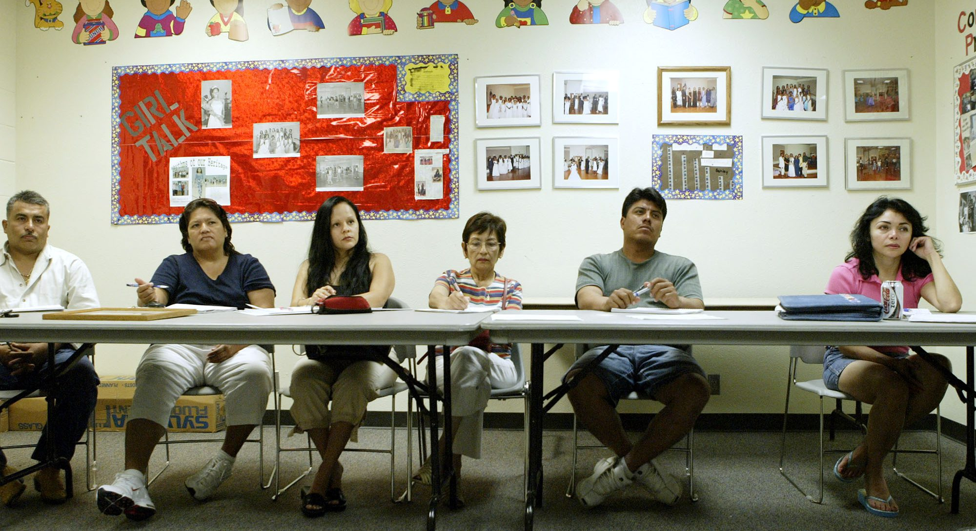 Students attend an English as a Second Language or ESL class at the Douglas Community Center June 8, 2006, in Plano, Texas.
