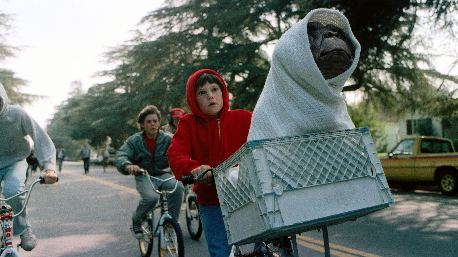 """FILE - This image released by Universal Pictures shows Henry Thomas as Elliott and E.T. in a basket on a bicycle in a scene from director Steven Spielberg's 1982 movie """"E.T.: The Extra-Terrestrial."""" As astronomers debate whether it would be a good idea to send signals into the universe to look for extra-terrestrial life, in science-fiction movies, aliens sometimes come in peace — and often do not. (AP Photo/Universal Pictures)"""