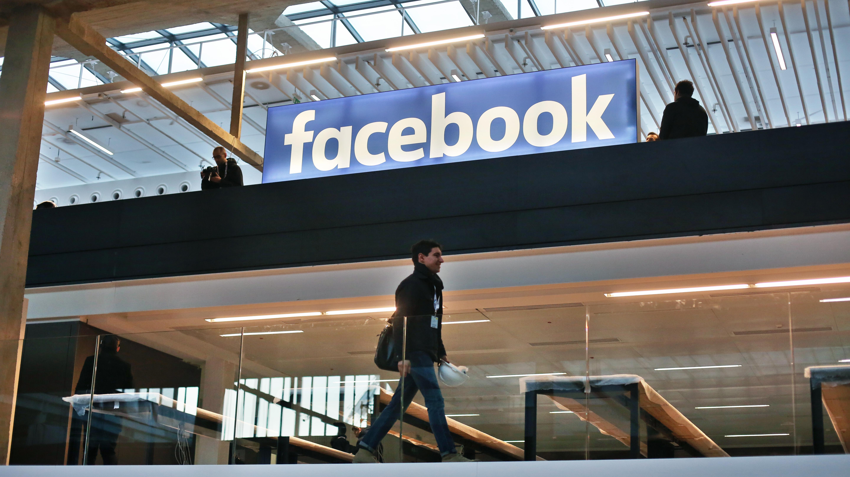 Facebook logo is displayed in a start-up companies gathering at Paris' Station F, in Paris, Tuesday, Jan. 17, 2017. (AP Photo/Thibault Camus)