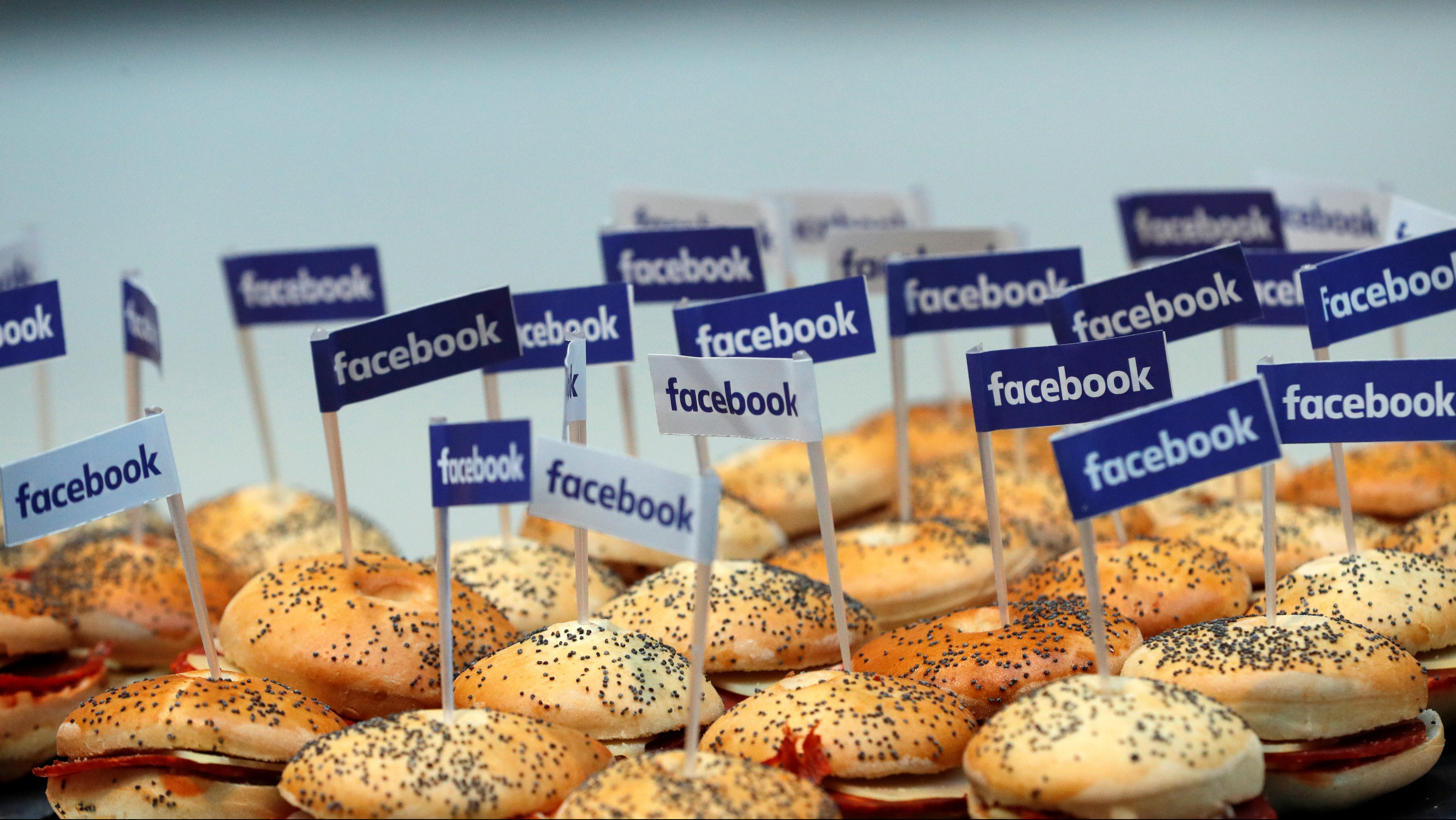Miniature Facebook banners are seen on snacks prepared for the visit by Facebook's Chief Operating Officer in Paris, France, January 17, 2017.  REUTERS/Philippe Wojazer - RC1840EBA560