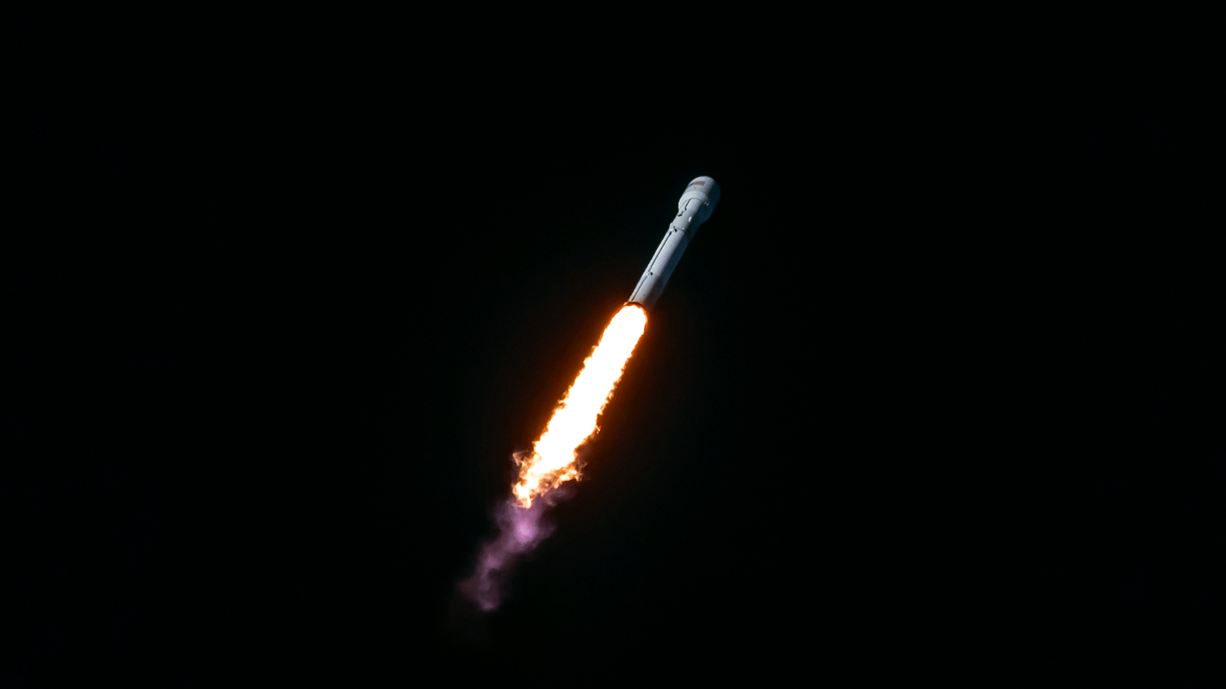 A SpaceX Falcon 9 booster flies to space in 2017.