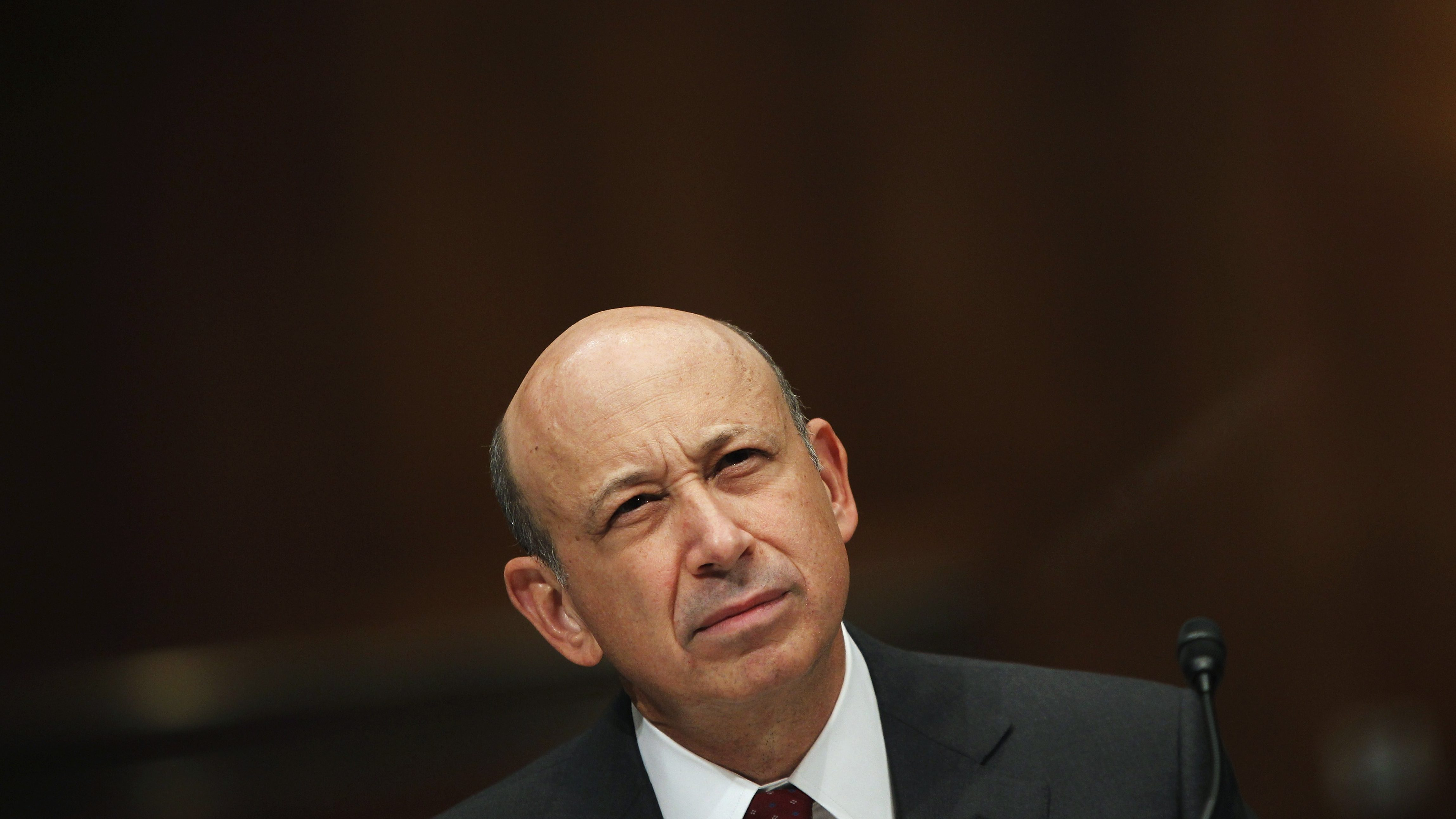 "CEO of Goldman Sachs Blankfein winces during testimony before the Senate Homeland Security and Governmental Affairs Investigations Subcommittee hearing on ""Wall Street and the Financial Crisis: The Role of Investment Banks"" on Capitol Hill in Washington"