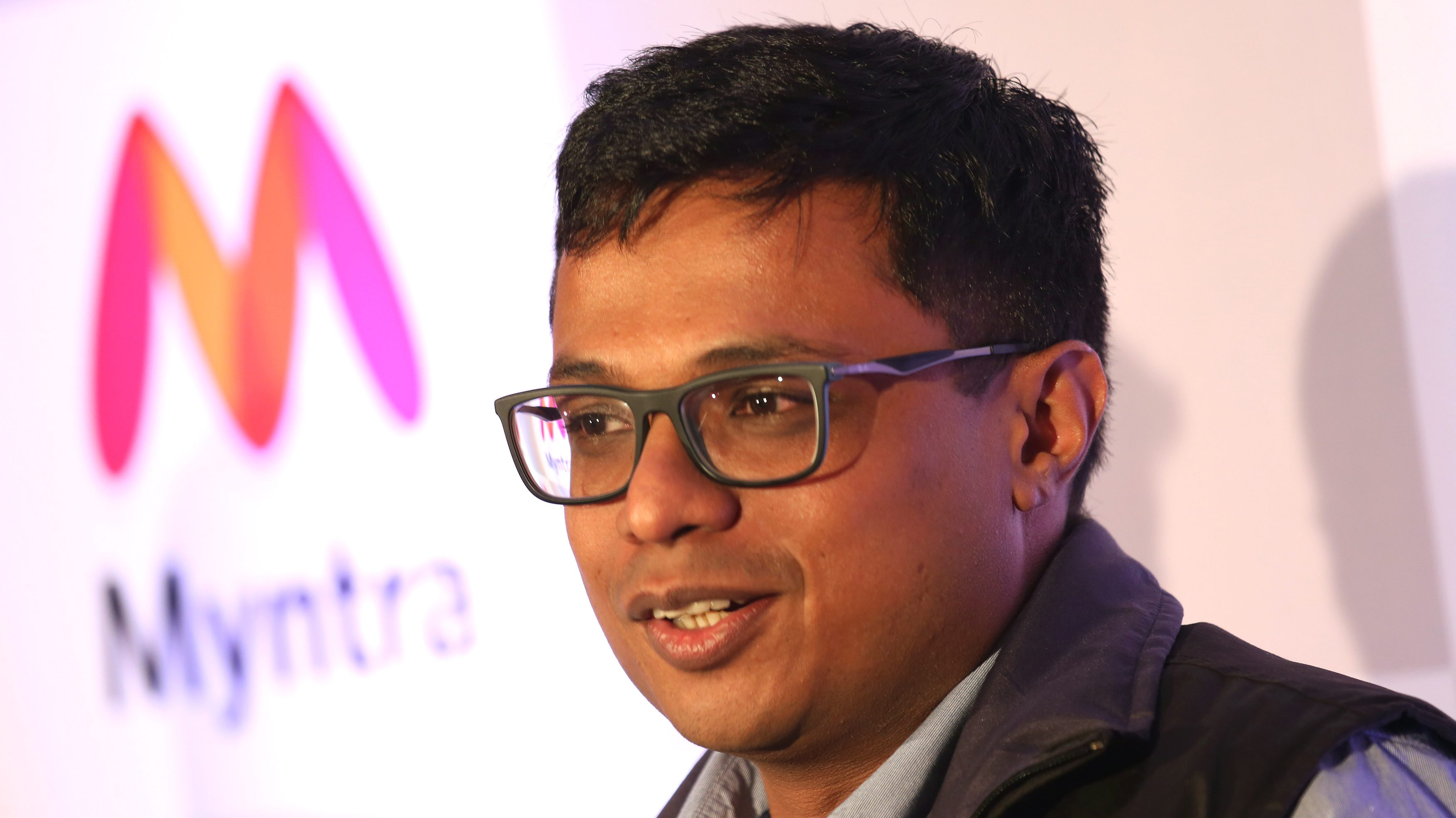 epa04744458 Flipkart CEO Sachin Bansal addresses a news conference in Bangalore, India, 12 May 2015. India?s e-commerce giants Flipkart and largest online fashion retailer Myntra will become a mobile app-only shopping platform starting 15 May, which intended to accelerate a consumer shift towards using smartphones to shop online, save cost and reduce dependence. The number of mobile Internet users in India is expected to reach 213 million by June, according to a 2014 report and it will be approximately 480 million mobile Internet users by end of 2017.  EPA/JAGADEESH NV