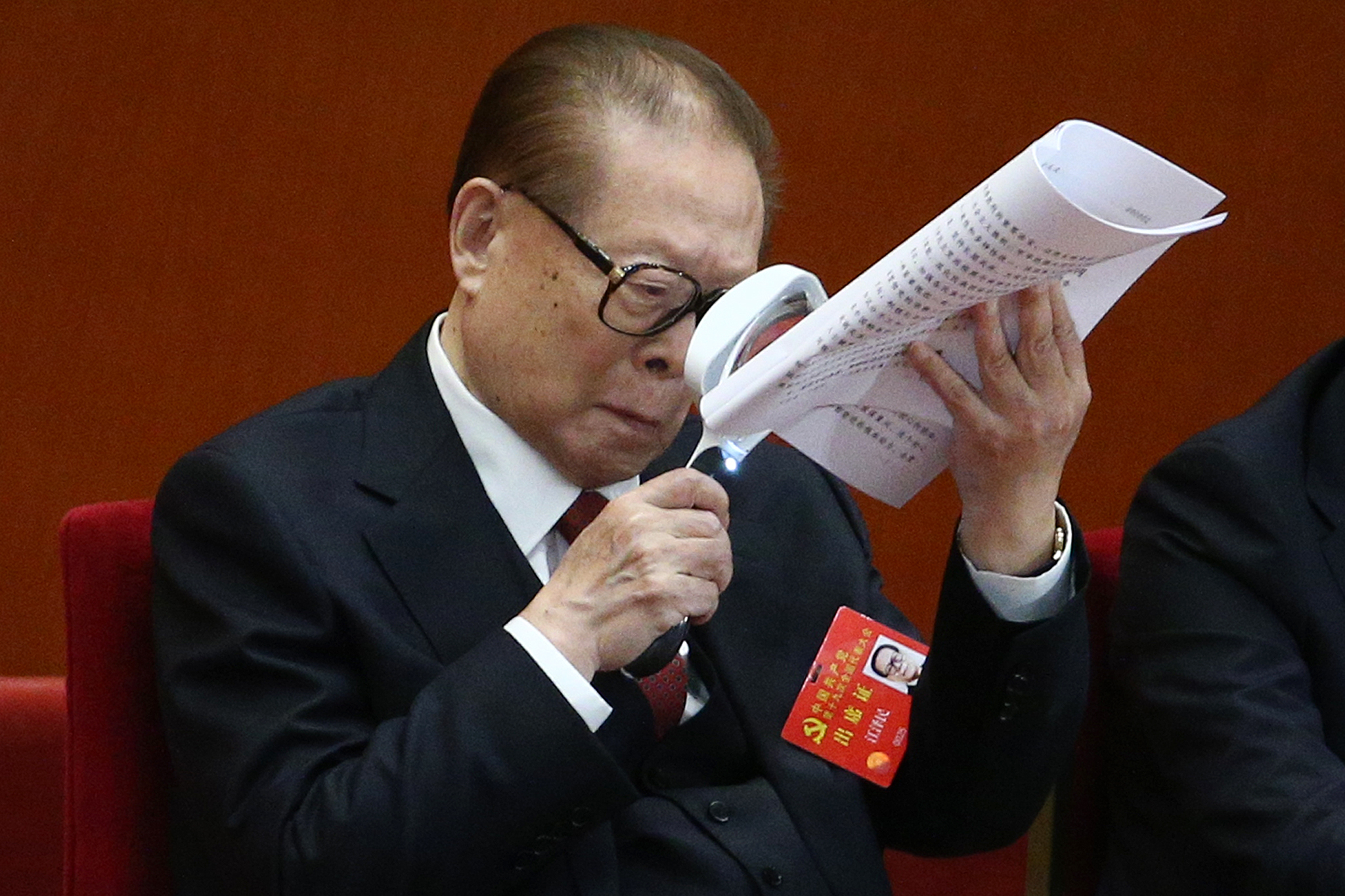Former Chinese President Jiang Zemin holds a magnifying glass while reading a document during the opening ceremony of the 19th National Congress of the Communist Party of China (CPC) at the Great Hall of the People (GHOP) in Beijing, China, 18 October 2017. China holds the 19th Congress of the Communist Party of China, the country's most important political event where the party's leadership is chosen and plans are made for the next five years. Xi Jinping is expected to remain as the General Secretary of the Communist Party of China for another five-year term.