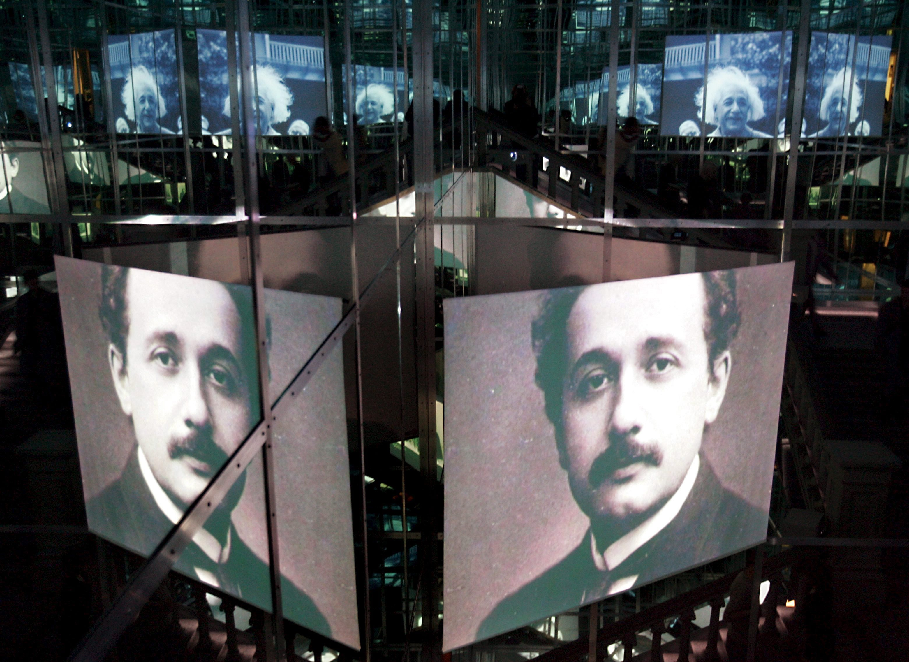 """Changing projections of portraits of physician Albert Einstein are on display in the staircase of the Historical Museum in Bern, Tuesday, June 14, 2005. To mark the centenary of the relativity theory and its discovery in Bern, the Historisches Museum (Historical Museum) in Bern, in cooperation with the Einstein Archive of the Swiss National Library, will present the special exhibition """"Einstein 05"""" on the physican's life and work covering an area of some 2,500 square metres from June 16 to April 17, 2006."""