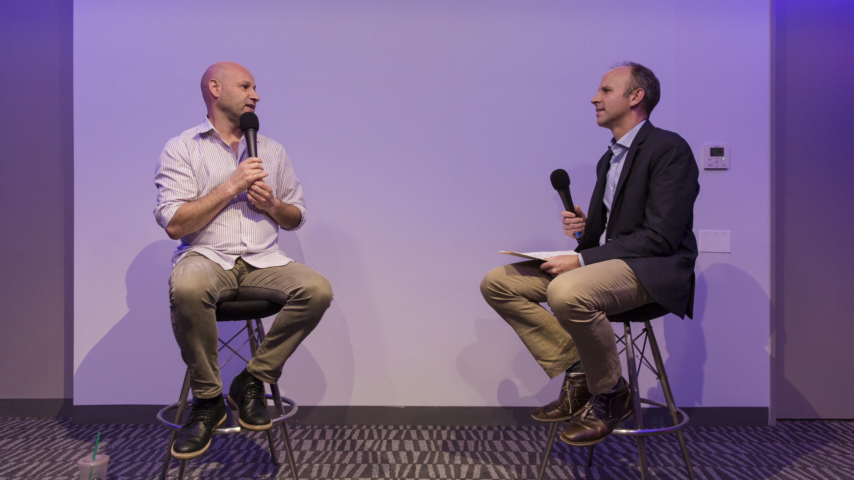 Joe Lubin, left, speaks at a Quartz and Retro Report event with Quartz editor-in-chief Kevin Delaney.