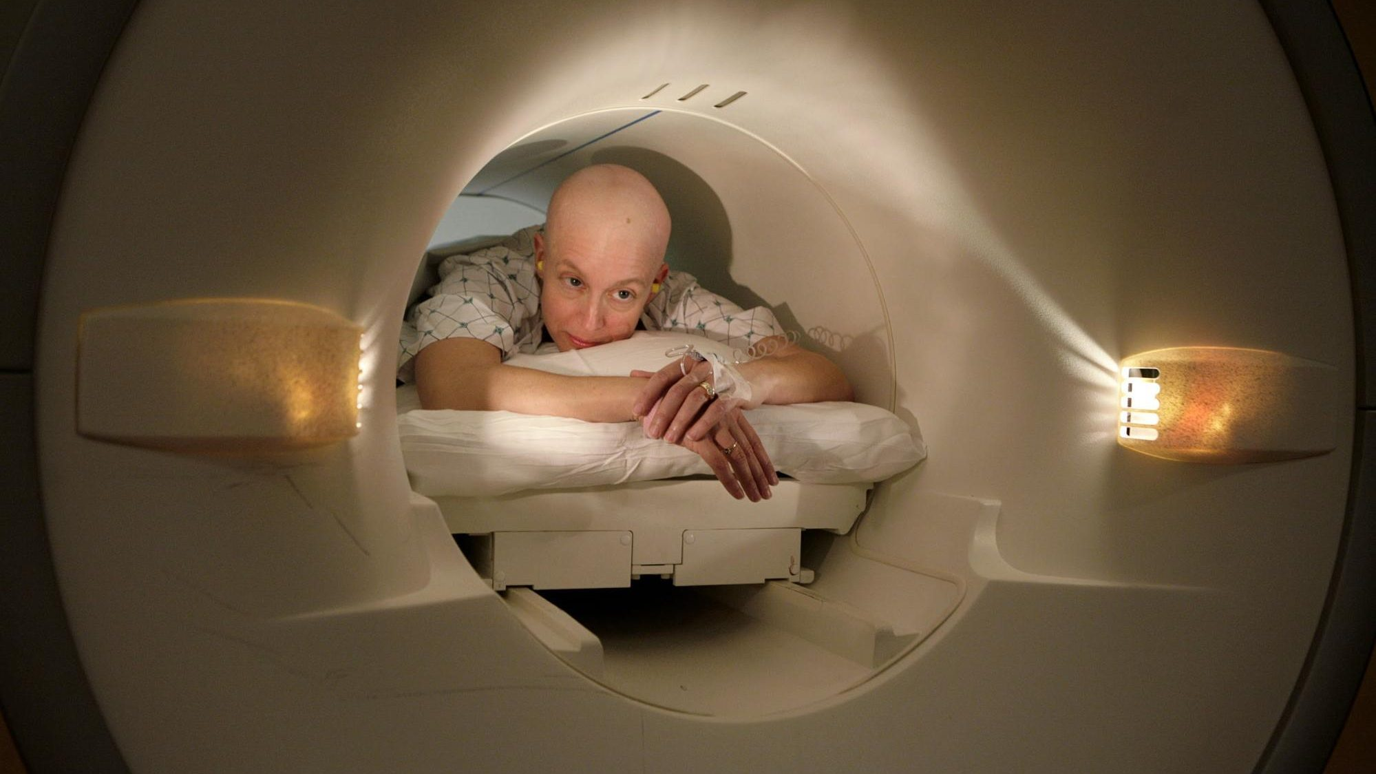 Cancer patient Deborah Charles lies inside the tube of a magnetic resonance imaging scanner during an MRI examination of her breasts at Georgetown University Hospital in Washington May 23, 2007.