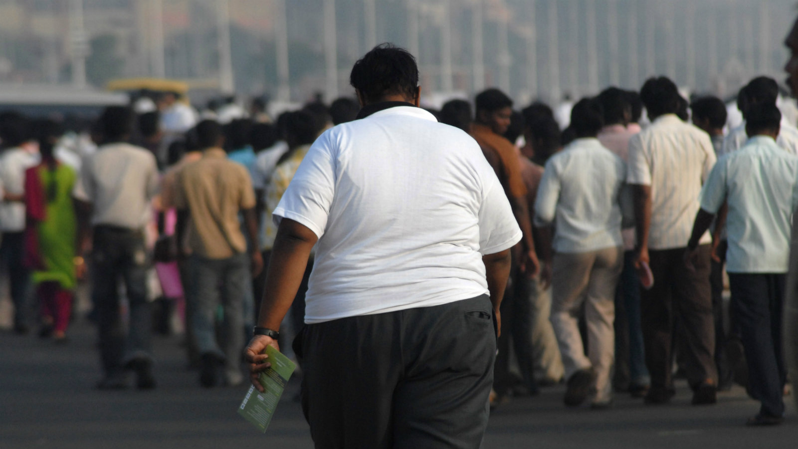 An over-weight Indian man takes part in a rally at the Marina Beach, Chennai, India, 05 December 2009. Obesity Foundation India organized the rally to create awareness about the perils of severe obesity with the theme being 'Obesity is a health hazard'. World Health Organization (WHO) officially classified that 1.2 billion people around the world are overweight and in India itself more than 25 per cent of the Indian population is overweight with statistics continuing to rise due to the changing lifestyle.