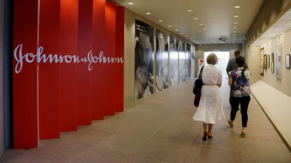 People walk along a corridor at the headquarters of Johnson & Johnson.
