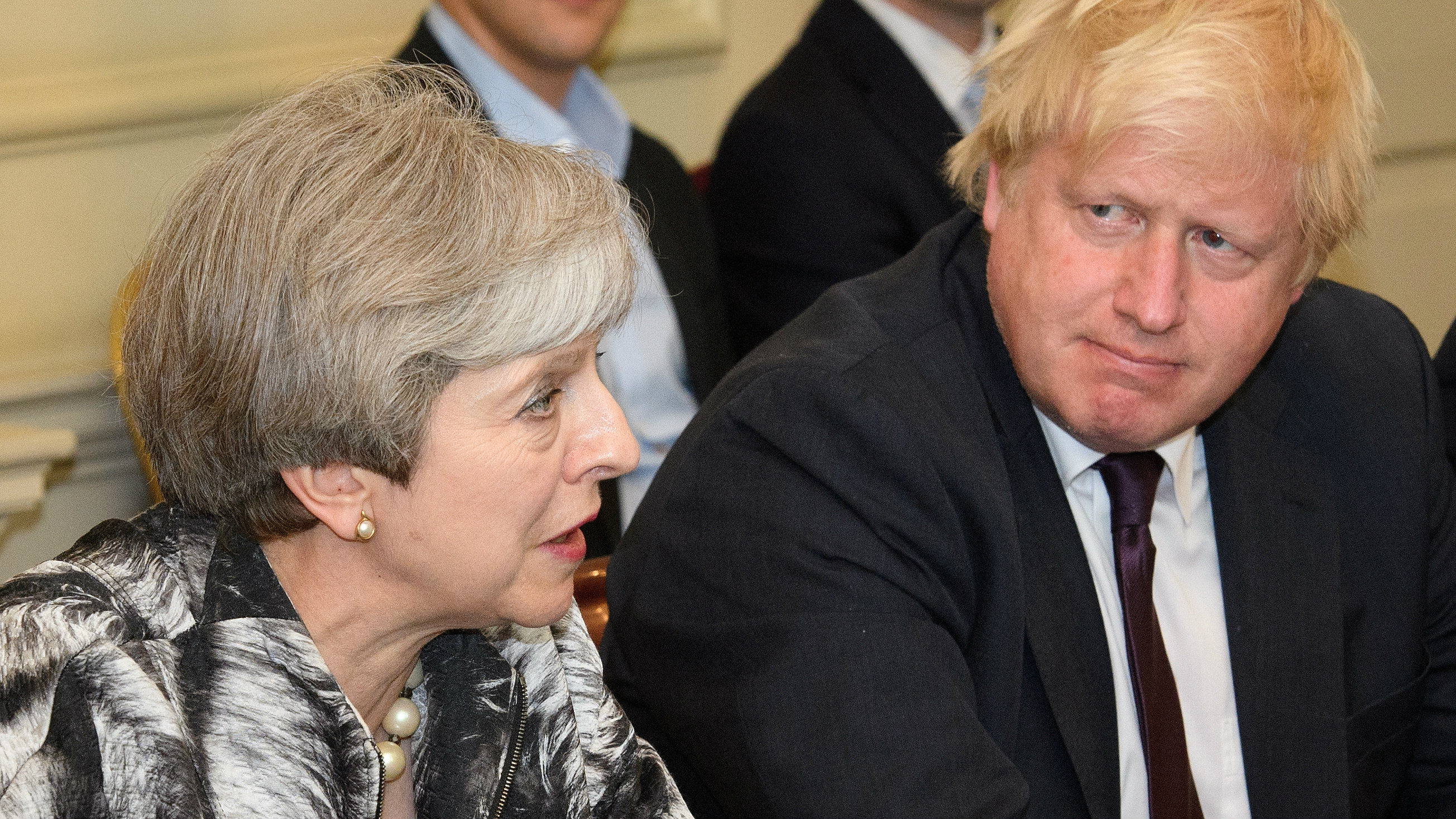 Britain's Prime Minister Theresa May sits next to Britain's Foreign Secretary Boris Johnson as she holds the first Cabinet meeting following the general election at 10 Downing Street, in London June 12, 2017.