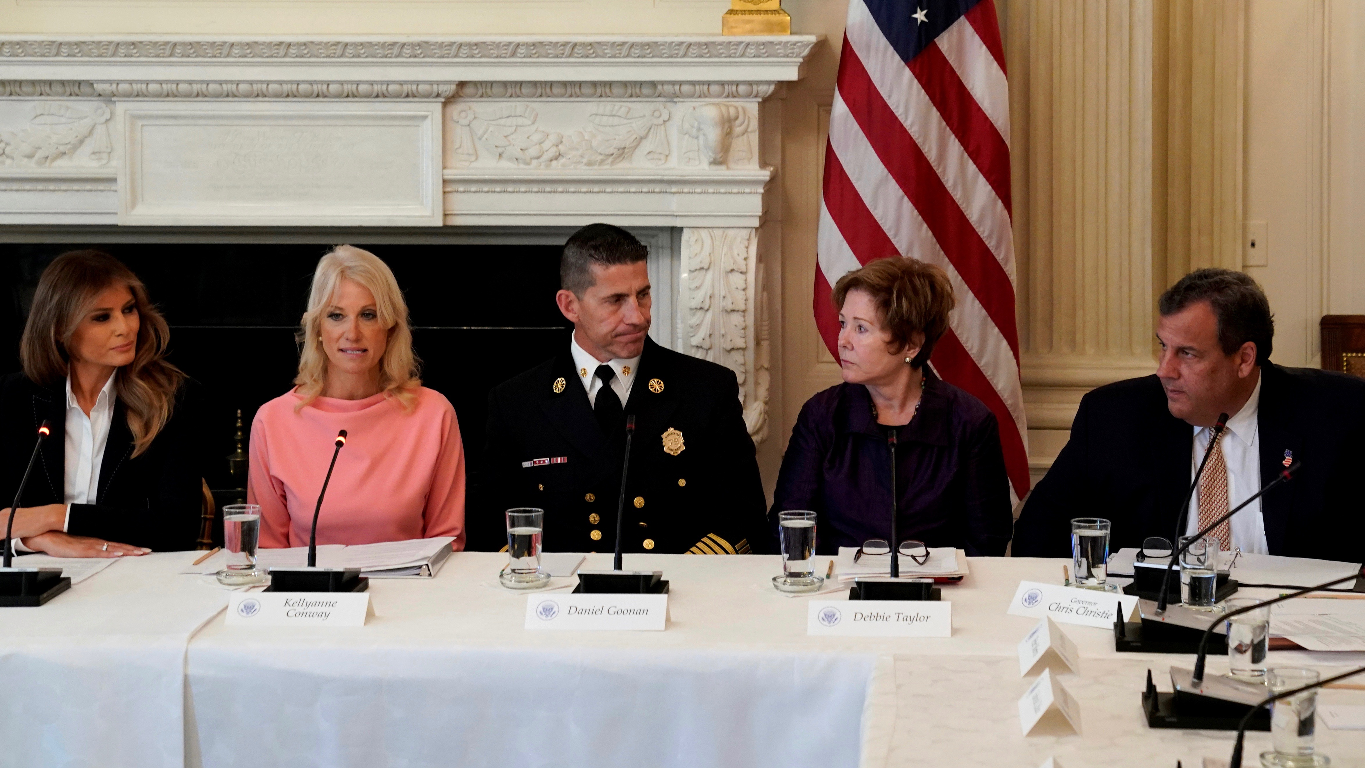 Melania Trump and Governor Chris Christie of New Jersey flank opioid experts in a discussion on the opioid crisis at the White House in Washington on Sept. 28.