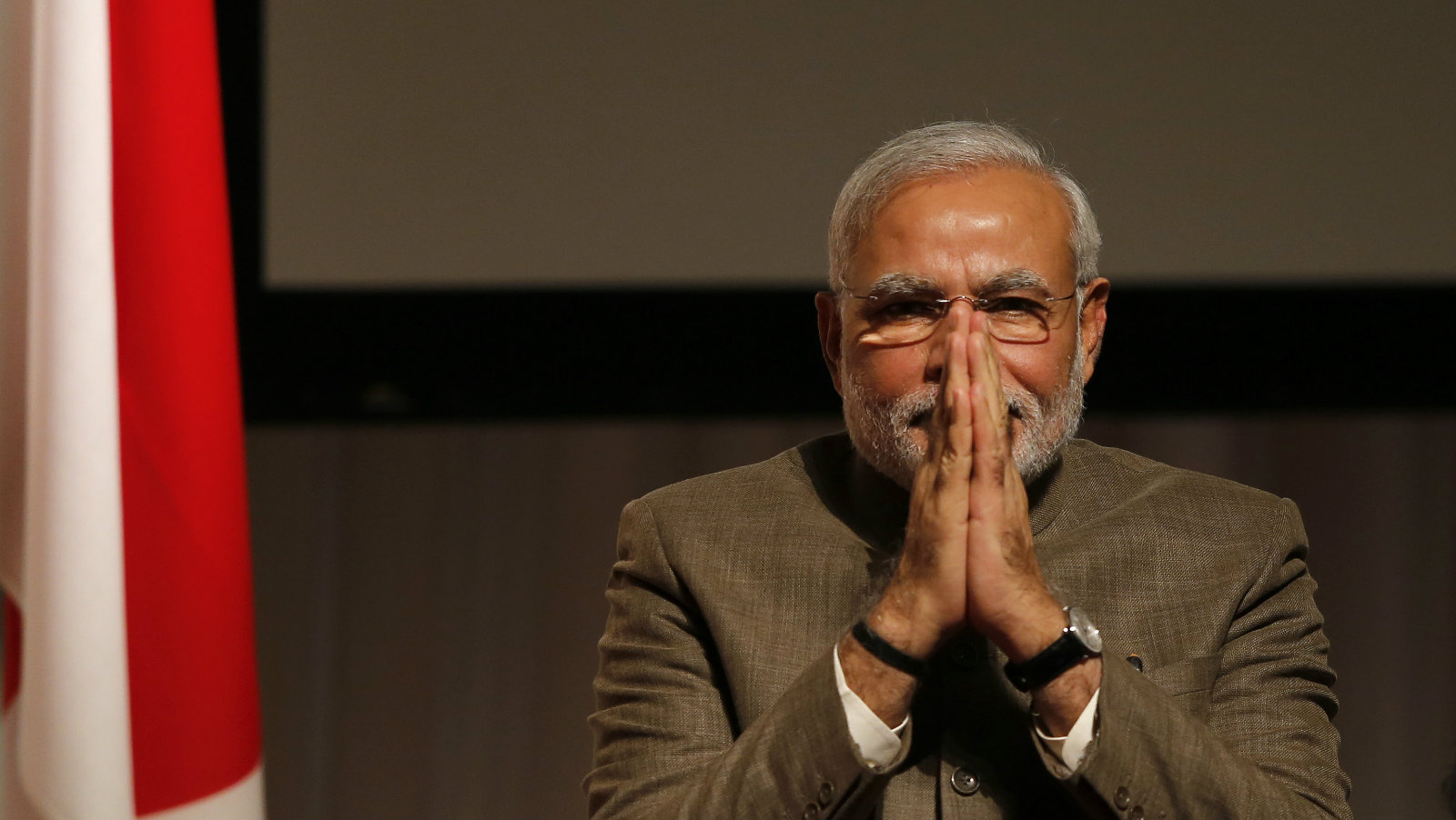 India's Prime Minister Modi gestures after giving a speech at his lecture meeting hosted by Nikkei Inc....