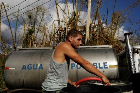 potable water brought once a day after Hurricane Maria crippled utilities near Guayama, Puerto Rico