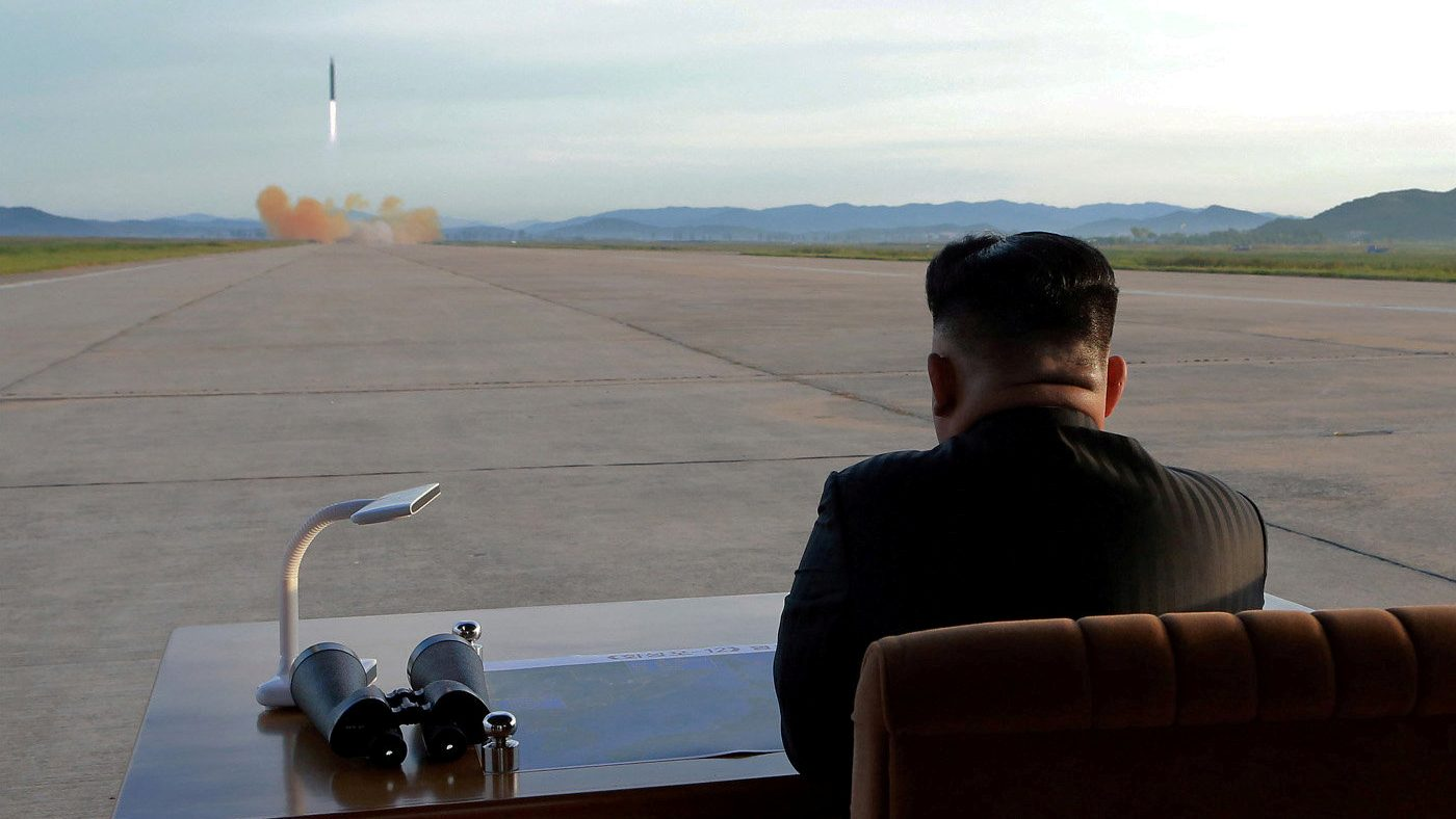 North Korean leader Kim Jong Un watches the launch of a Hwasong-12 missile in this undated photo released by North Korea's Korean Central News Agency (KCNA) on September 16, 2017. KCNA via