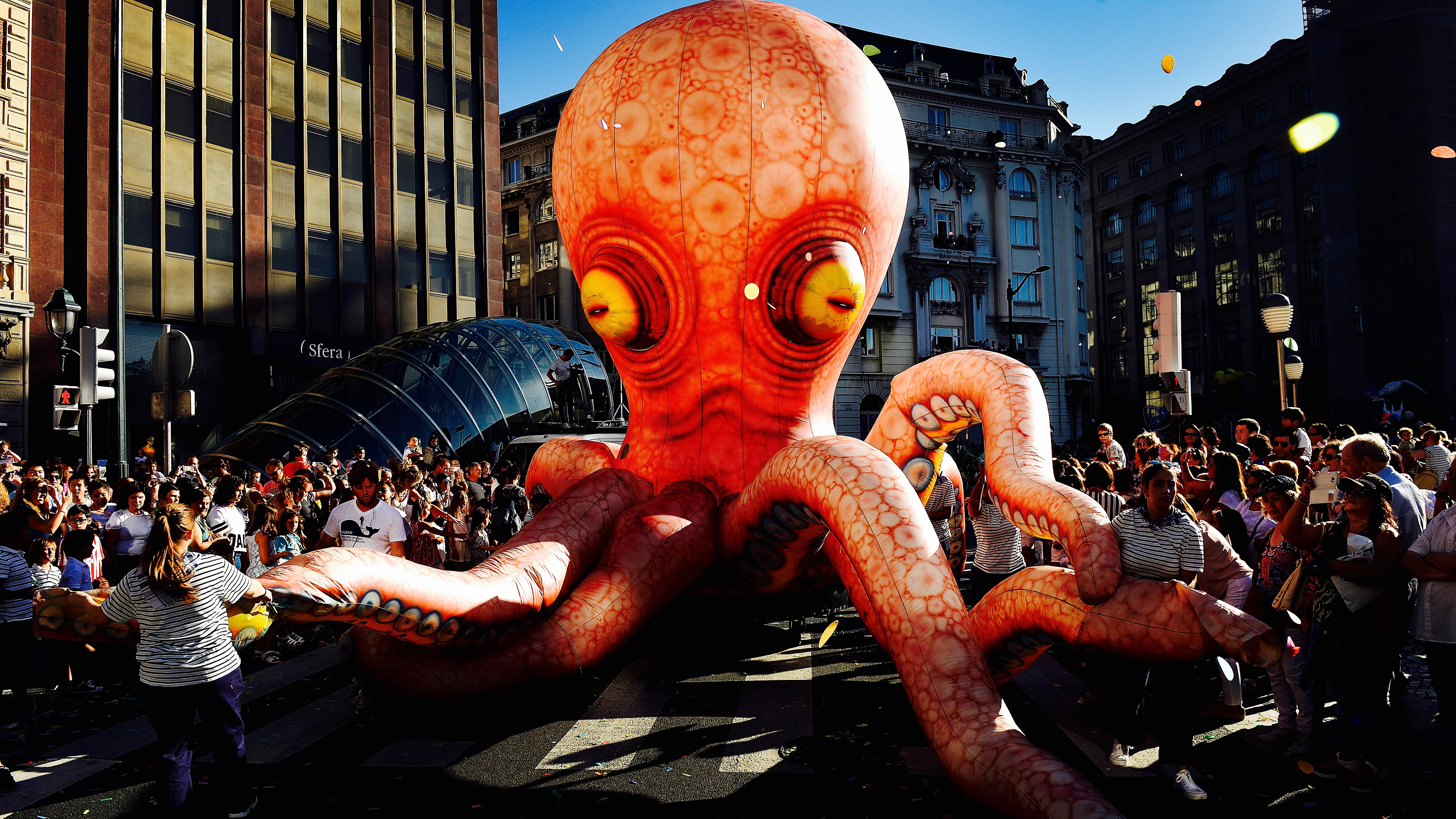 Inflatable octopus at a parade.