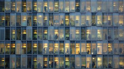 """Lights are on as people work in their offices in a skyscraper in downtown Milan, February 17, 2015. REUTERS/Stefano Rellandini/File Photo GLOBAL BUSINESS WEEK AHEAD PACKAGE - SEARCH """"BUSINESS WEEK AHEAD JULY 25"""" FOR ALL IMAGES - S1BETRNKOMAC"""