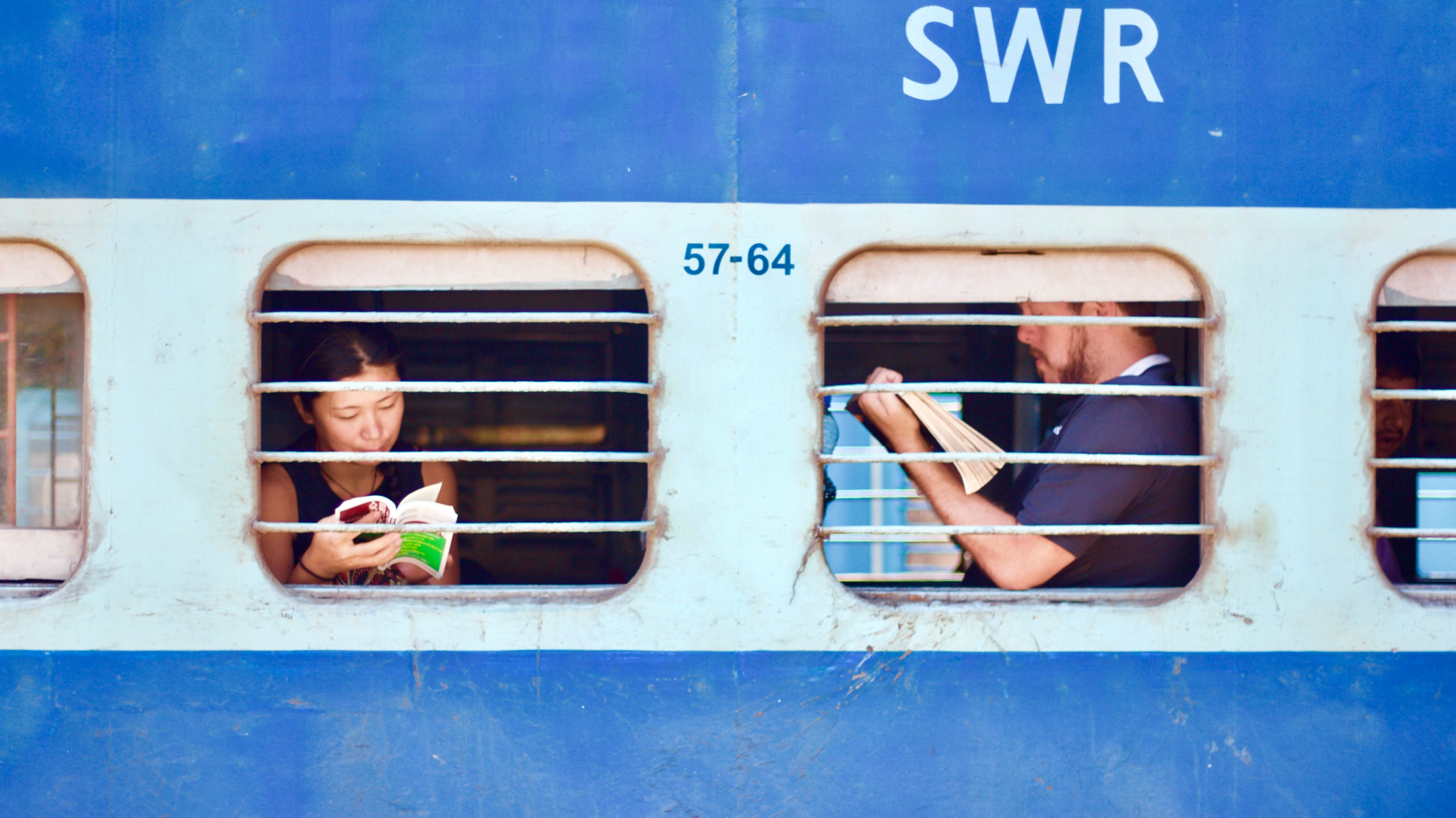People reading on train in India