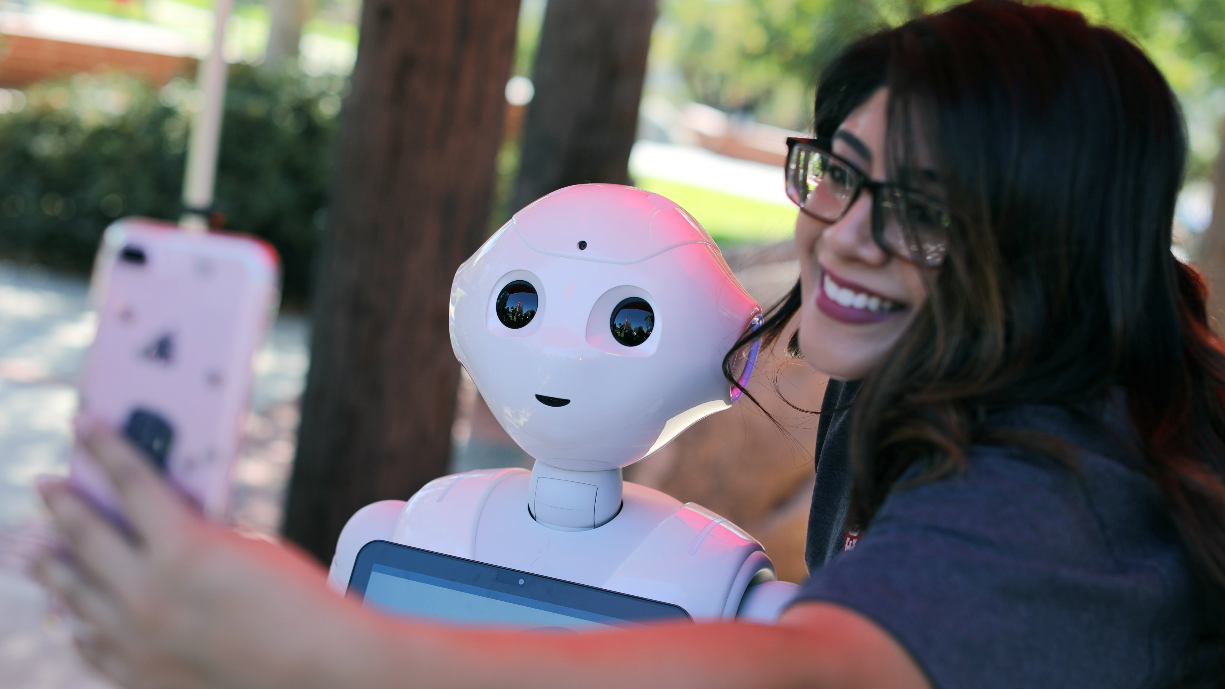 """San Marcos student Amaris Gonzalez takes a selfie with """"Pepper"""" an artificial Intelligence project utilizing a humanoid robot from French company Aldebaran and reprogramed as an assistant for students attending Palomar College in San Marcos, California, U.S. October 10, 2017."""