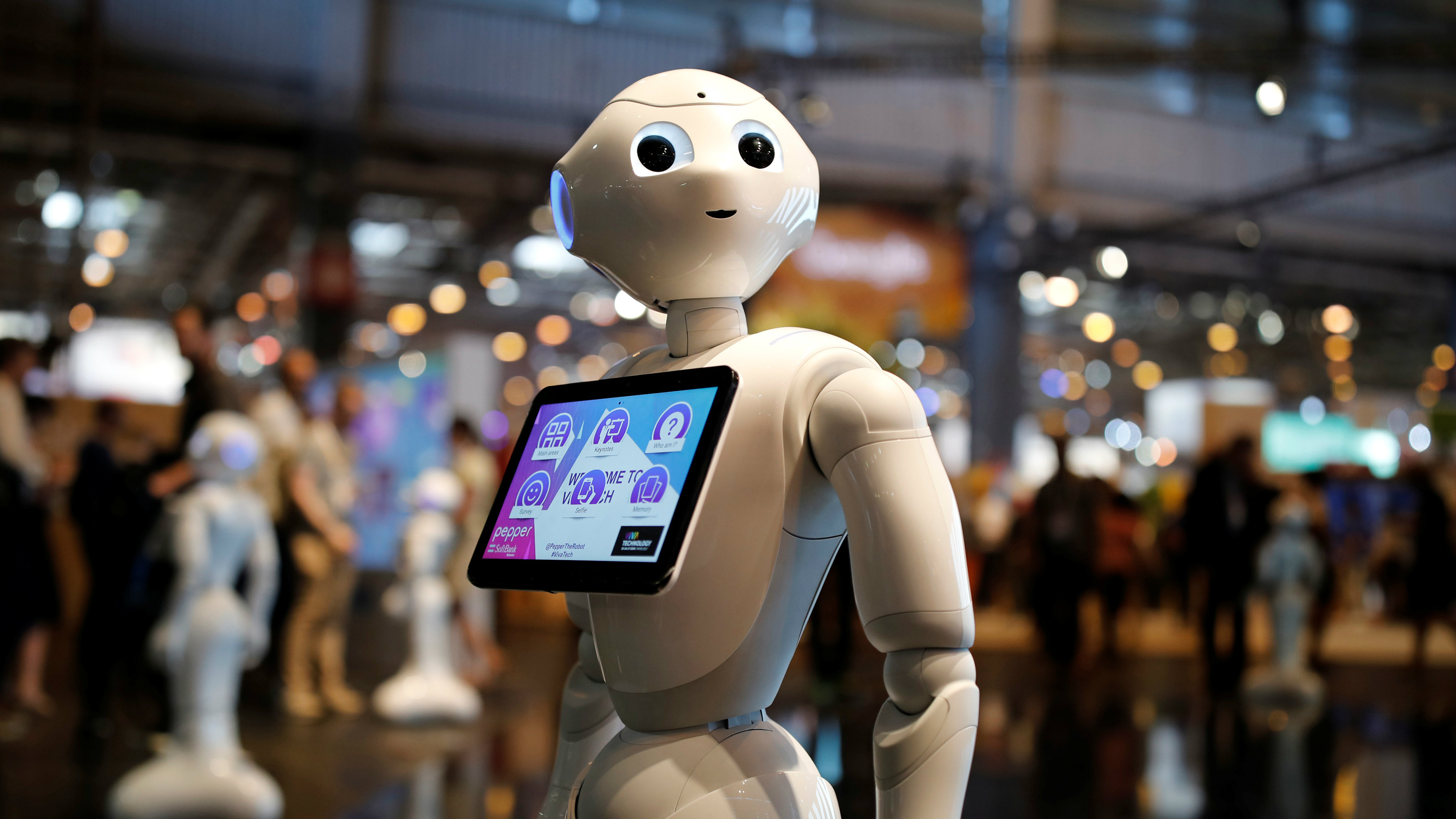 A 'Pepper' humanoid robot, manufactured by SoftBank Group Corp., stands at the Viva Technology conference in Paris, France, June 15, 2017.