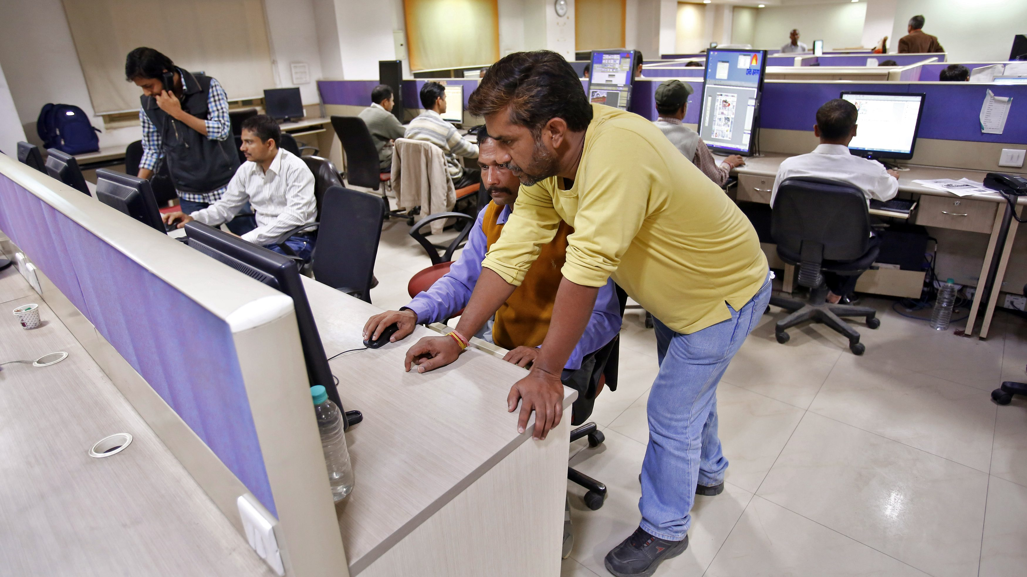 Employees work inside the office of Dainik Jagran newspaper in Noida