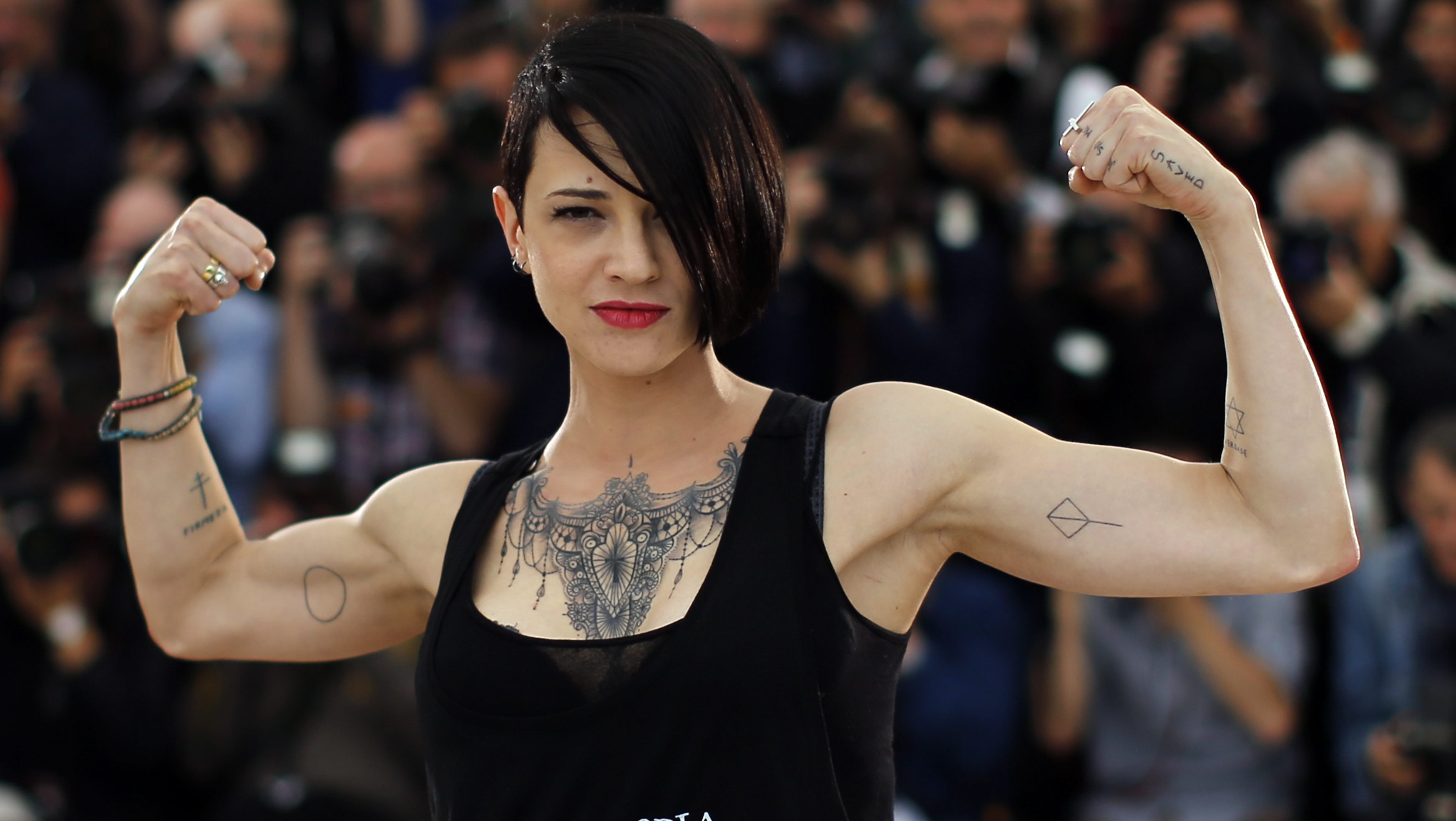 """Director Asia Argento poses during a photocall for the film """"Incompresa"""" (Misunderstood) in competition for the category """"Un Certain Regard"""" at the 67th Cannes Film Festival in Cannes May 22, 2014             REUTERS/Eric Gaillard (FRANCE  - Tags: ENTERTAINMENT)   - LR2EA5M0V0ZPV"""