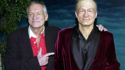 HUGH HEFNER POSES AT HOLLYWOOD WAX MUSEUM UNVEILING.