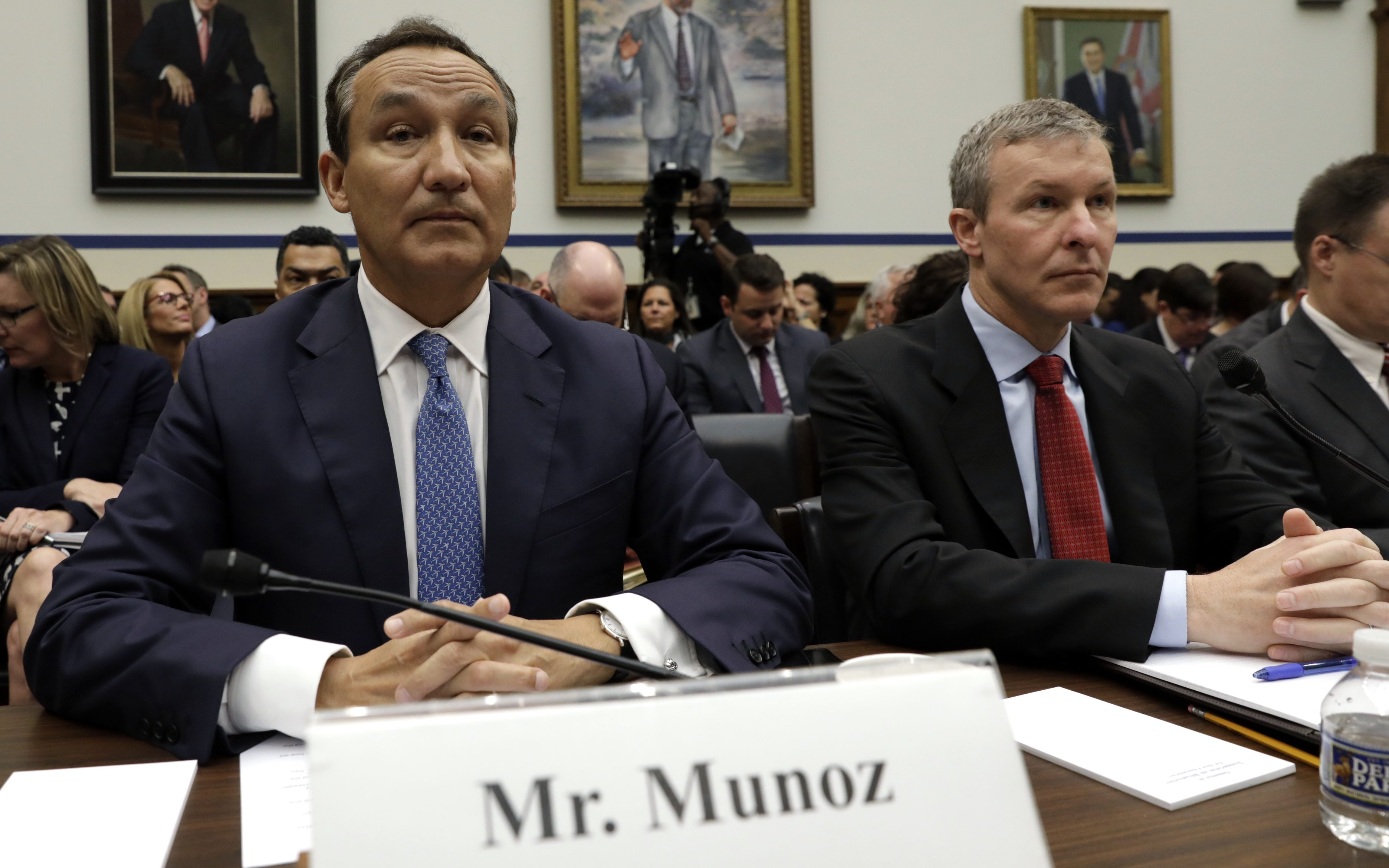 """United Airlines CEO Oscar Munoz (L) and UAL President Scott Kirby prepare to testify at a House Transportation and Infrastructure Committee hearing on """"Oversight of U.S. Airline Customer Service,"""" in the aftermath of the forced removal on April 9 of a passenger from a UAL Chicago flight, on Capitol Hill in Washington, U.S., May 2, 2017. REUTERS/Kevin Lamarque - HP1ED5211NJ53"""