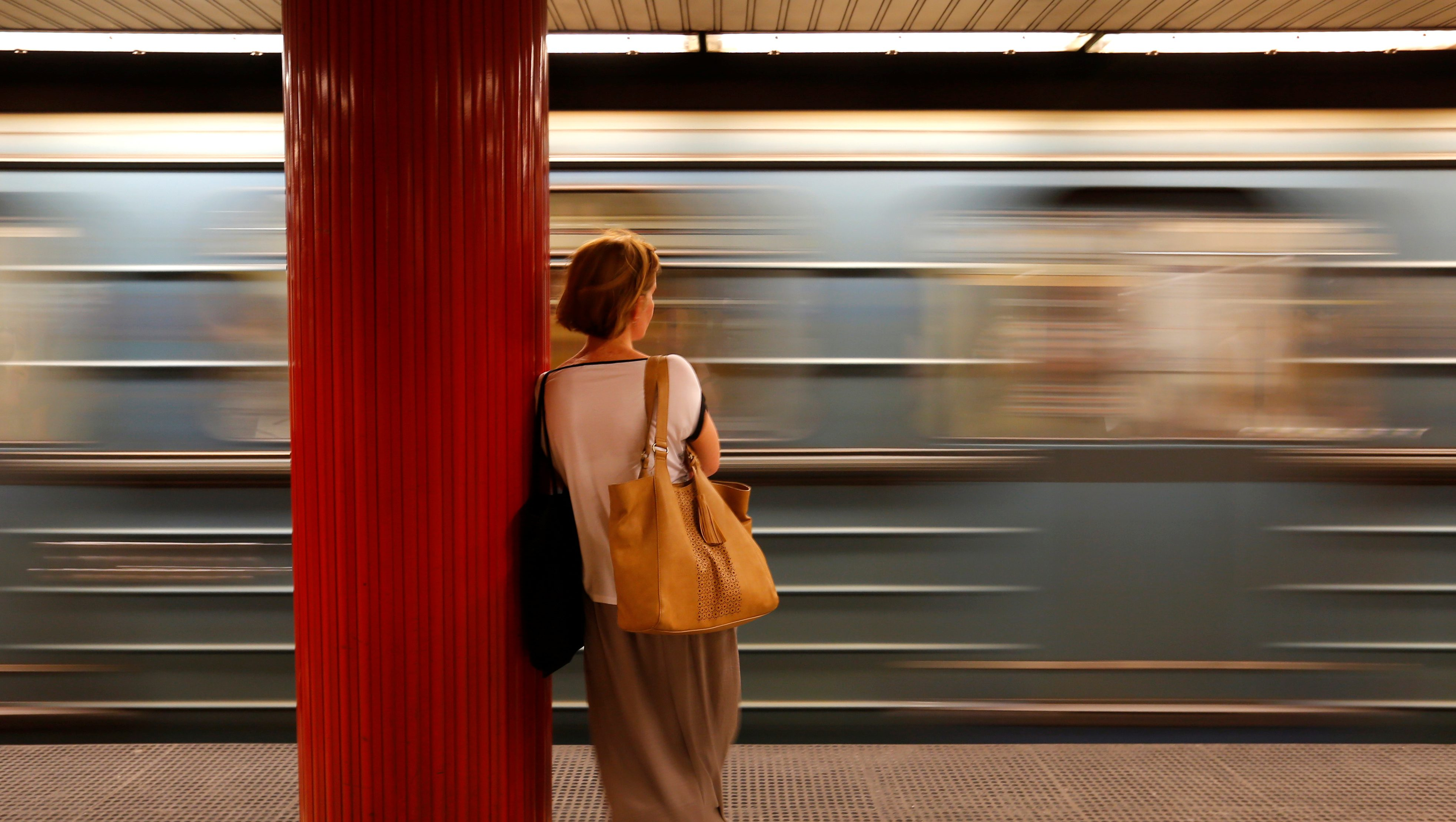 A commuter waits for a train at a subway station in Budapest.