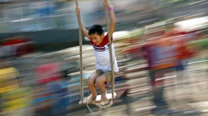 A boy plays on a traditional swing during Dashain, the biggest religious festival for Hindus in Nepal, in Kathmandu