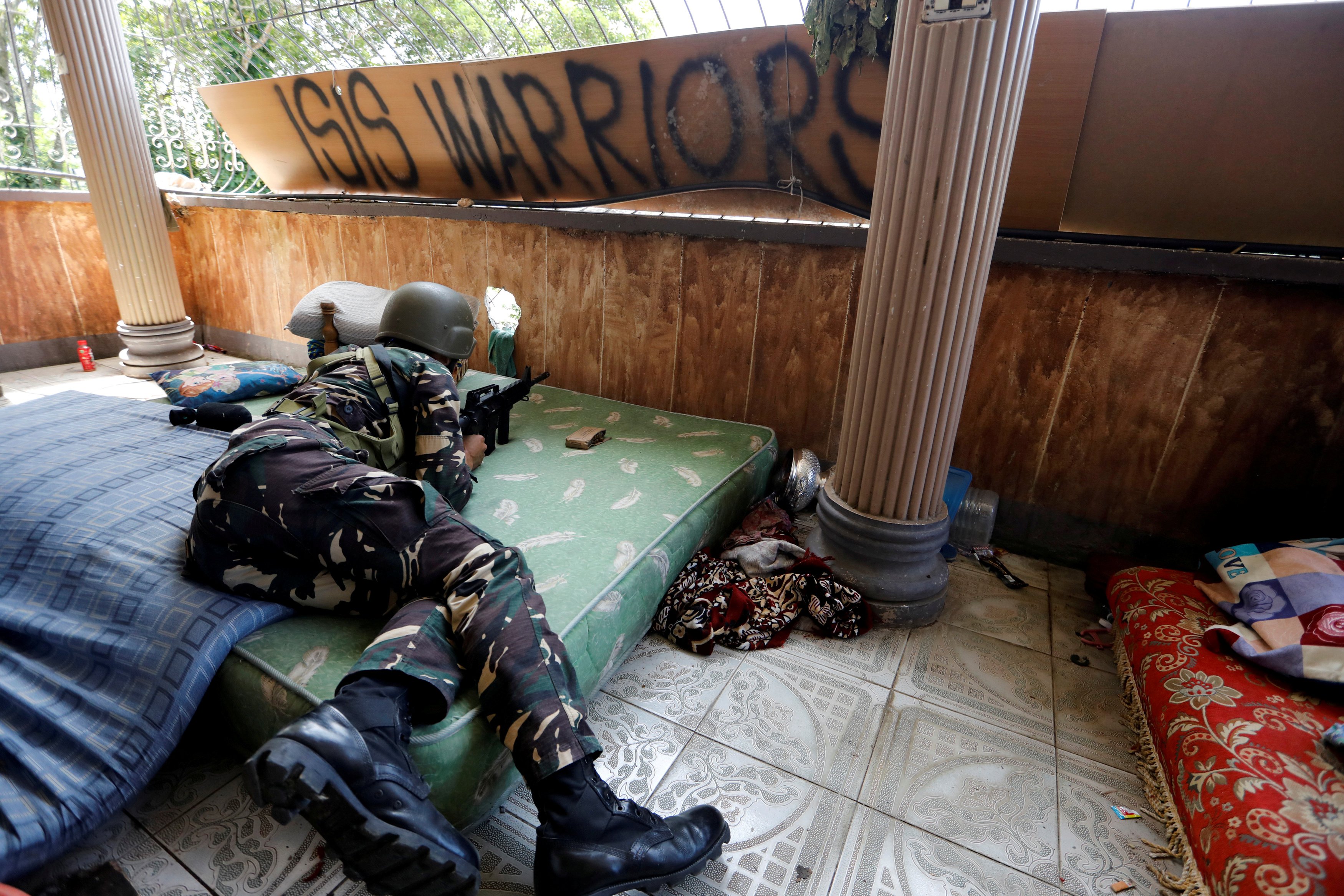 FILE PHOTO: A Filipino soldier lies on a mattress at their combat position in a house as government troops continue their assault against insurgents from the Maute group in Marawi city, Philippines July 1, 2017.