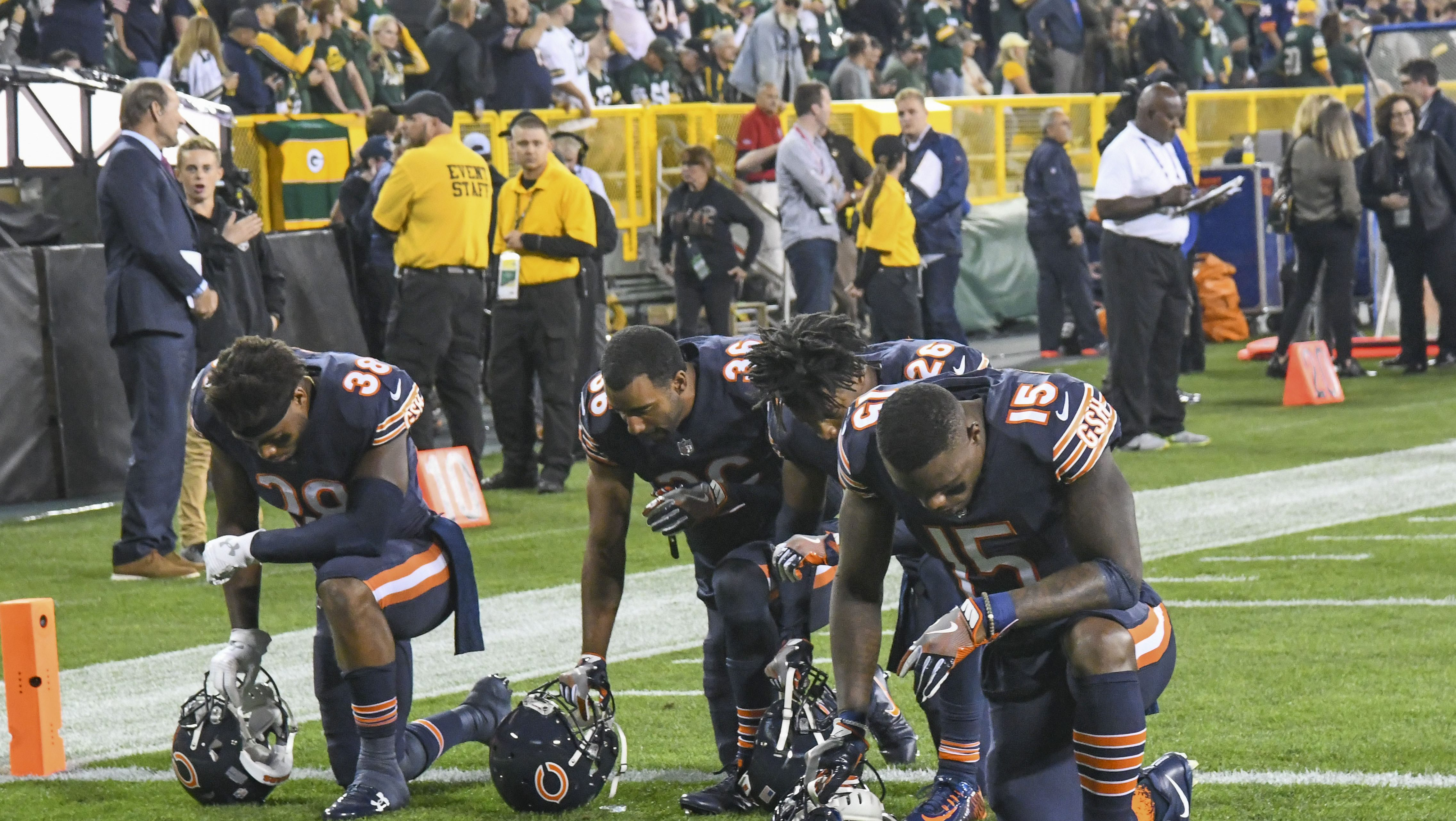 Chicago Bears players kneel in the end zone prior to their game the Green Bay Packers against before the national anthem at Lambeau Field.
