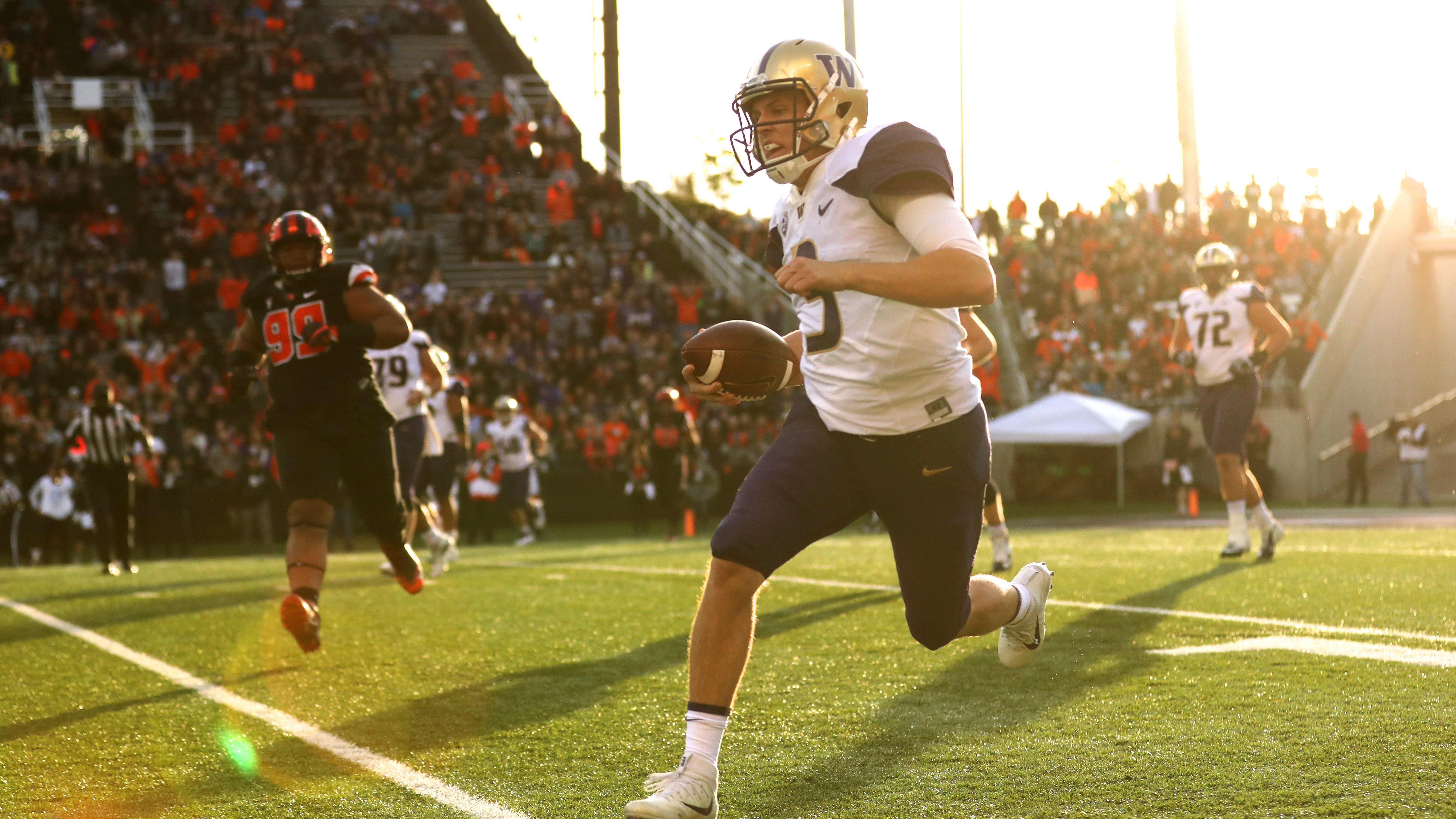 Sep 30, 2017; Corvallis, OR, USA; Washington Huskies quarterback Jake Browning (3) runs upfield Oregon State Beavers in the first half at Reser Stadium. Mandatory Credit: Jaime Valdez-USA TODAY Sports - 10318824