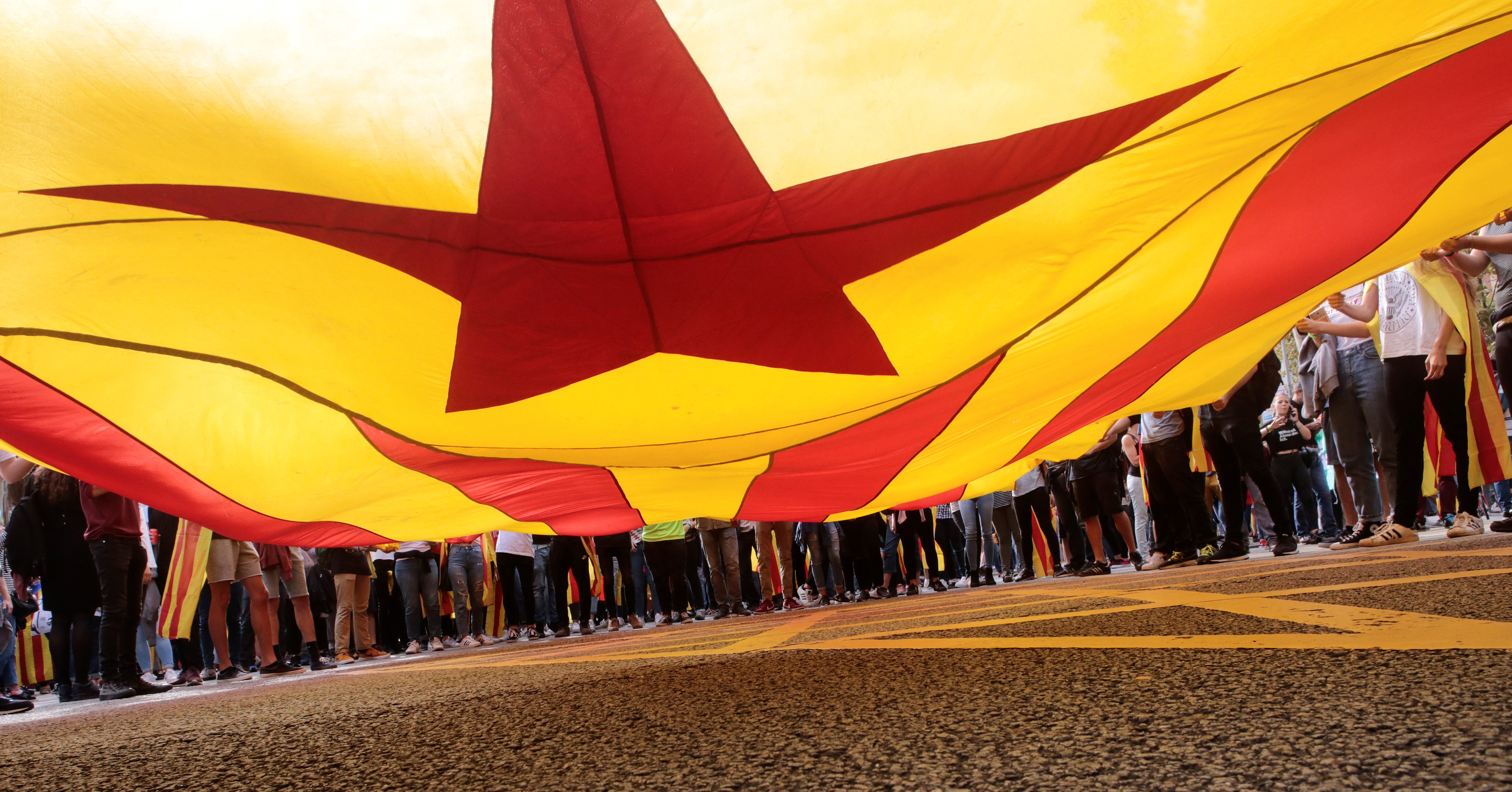 Students hold a large Catalan separatist flag during a demonstration two days after the banned independence referendum in Barcelona, Spain October 3, 2017.