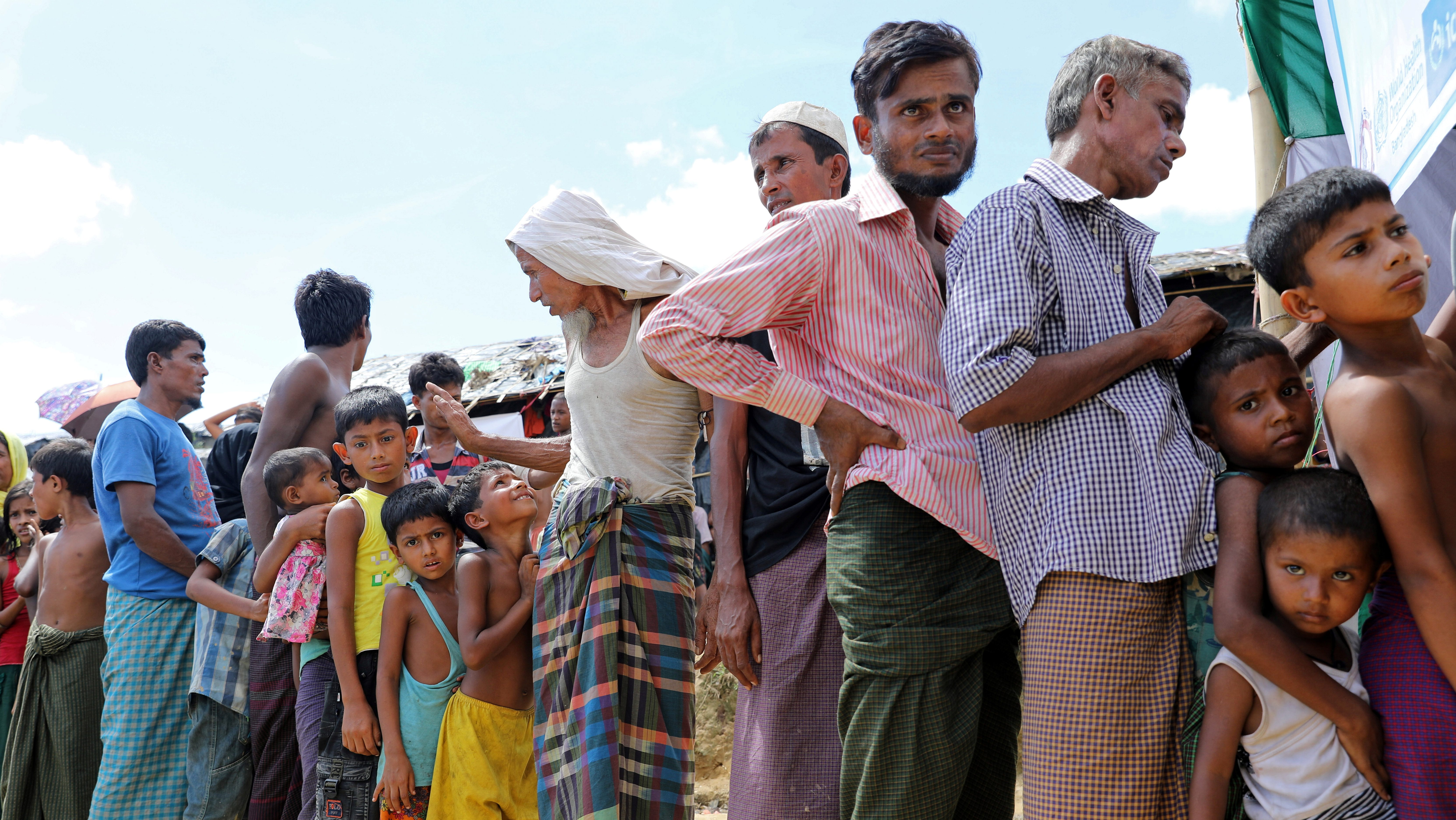 Rohingya refugees gather in front of a temporary healthcare center to get an oral cholera vaccine, distributed by the World Health Organisation (WHO), in the Jamtoli refugee camp in Cox's Bazar, Bangladesh October 10, 2017. REUTERS/Mohammad Ponir Hossain - RC188D3E6700